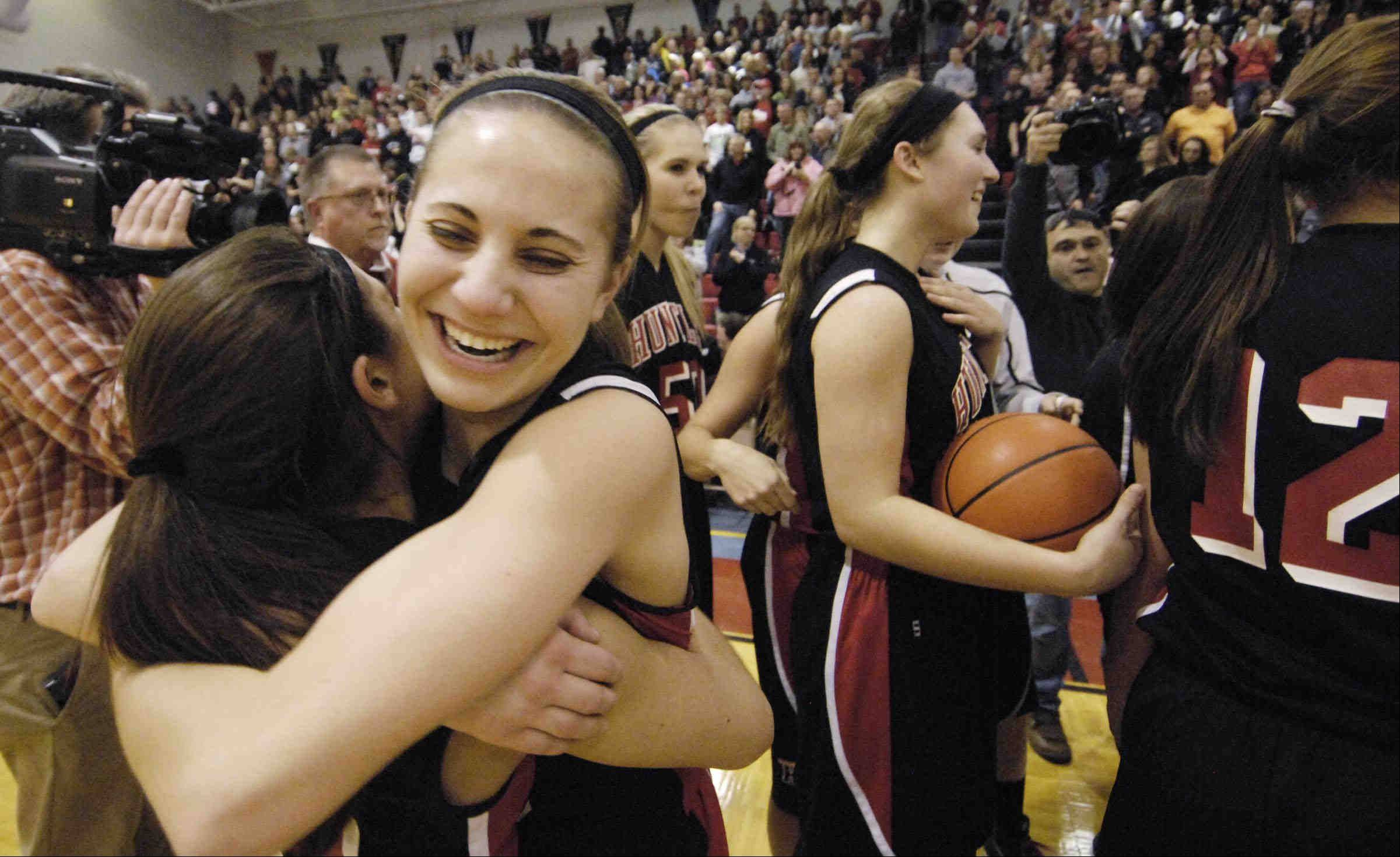 Huntley's Amanda Kaniewski laughs with teammate Kayla Barreto after defeating Wheaton Warrenville South Monday in the Class 4A Dundee-Crown supersectional game in Carpentersville.