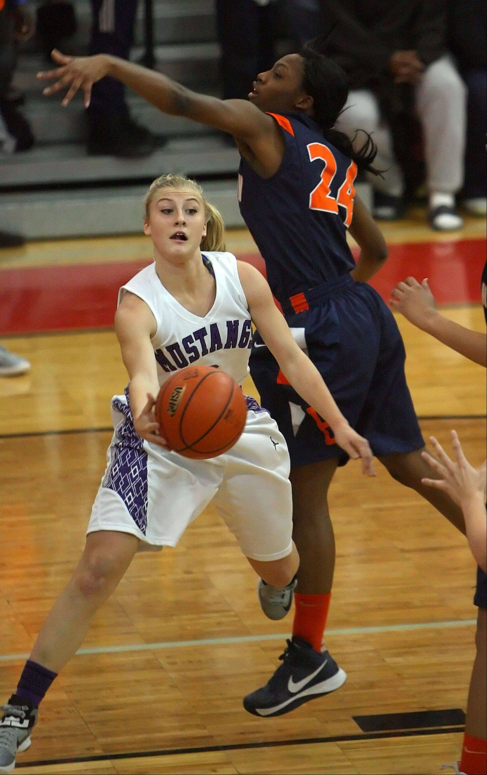Rolling Meadows' Jackie Kemph drives on Evanston's Sierra Clayborn during Monday's supersectional game.