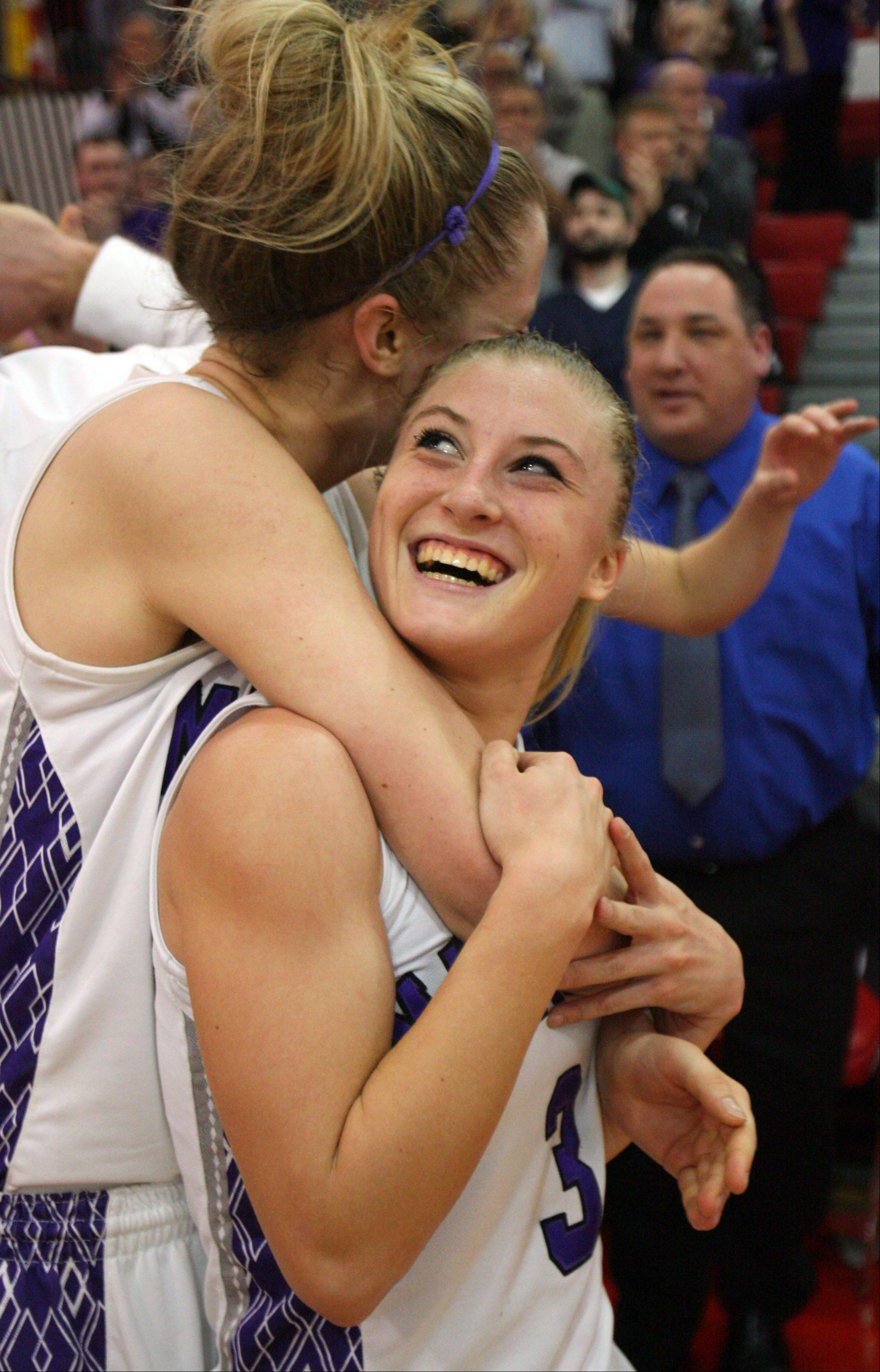 Rolling Meadows' Jenny Vliet, left, and Jackie Kemph celebrate after beating Evanston Monday night.