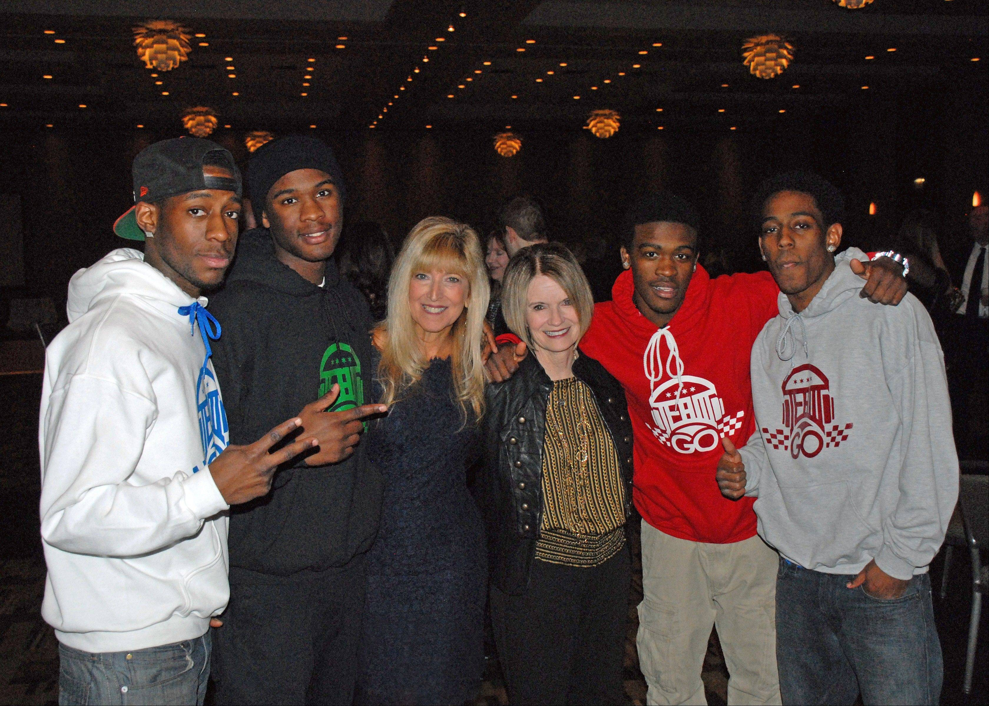 The rap group TeamGo! takes a break from their performance at a recent CASA Lake County Volunteer Appreciation Dinner to join CASA Executive Director Terri Zenner Greenberg, left, and Juvenile Court Judge Sarah Lessman at a recent Volunteer Appreciation Awards dinner in The Westin Chicago North Shore. TeamGo! was led by a former CASA child who wanted to give back to the organization.