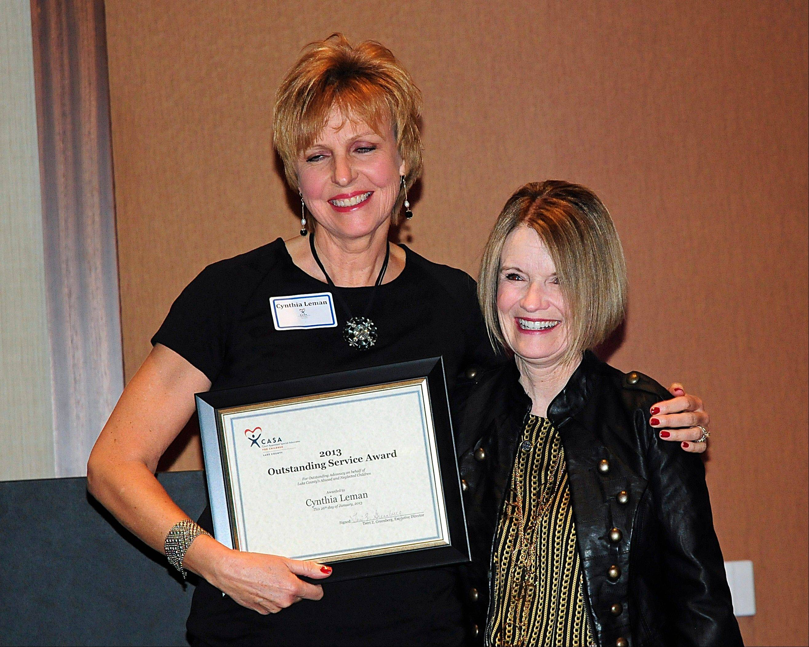 Juvenile Court Judge Sarah Lessman, right, presents CASA Volunteer Advocate Cynthia Leman of Grayslake a 2013 Outstanding Service Award at a recent Volunteer Appreciation Awards dinner at The Westin Chicago North Shore. The nonprofit's volunteers advocated for a record number of 577 abused children in 2012. CASA Lake County is celebrating its 20th year of advocacy for abused and neglected children.