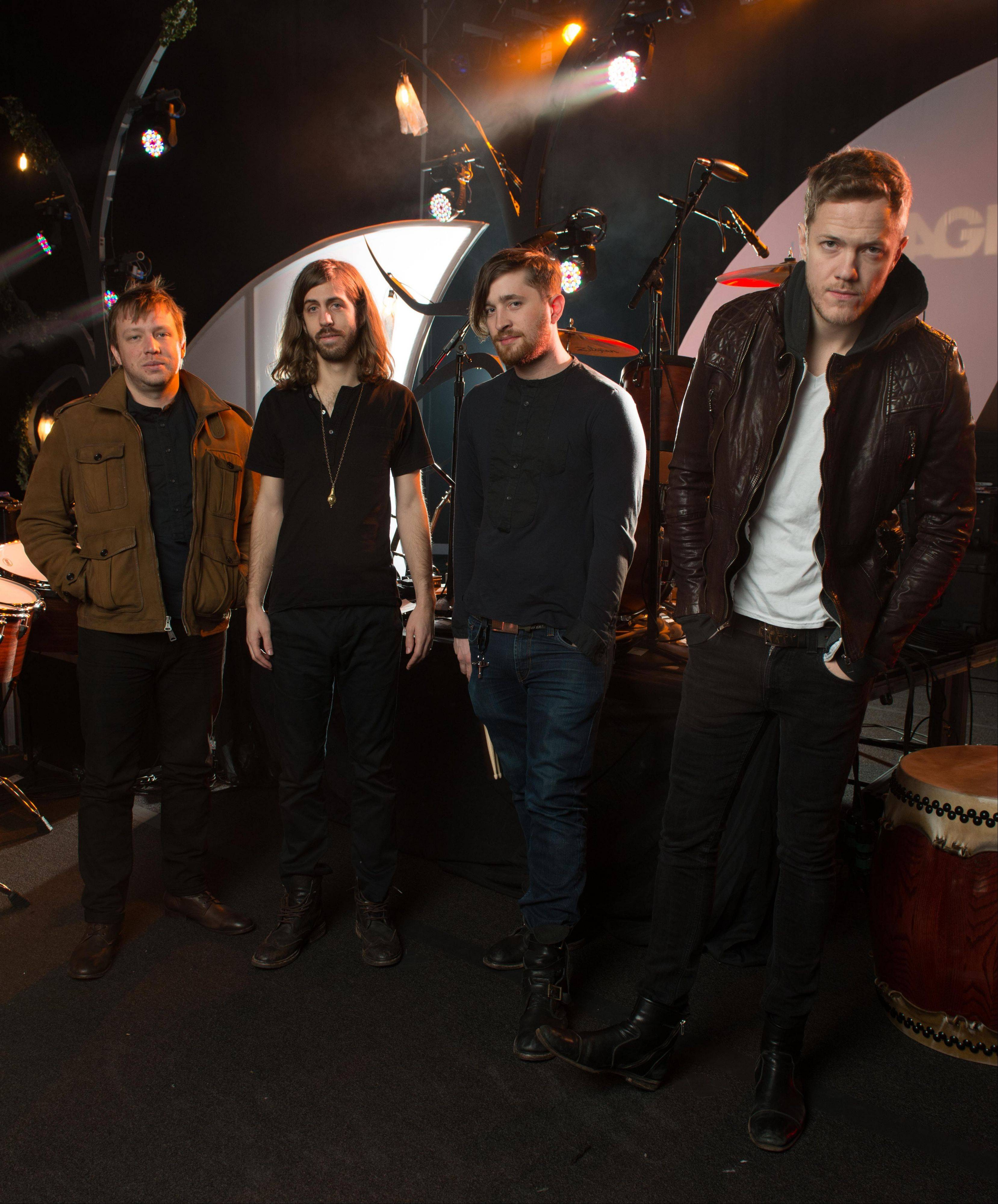 "Las Vegas-based rock band Imagine Dragons – from left, Ben McKee, Wayne Sermon, Dan Platzman and Dan Reynolds – has reached gold status with its debut album, ""Night Visions."""