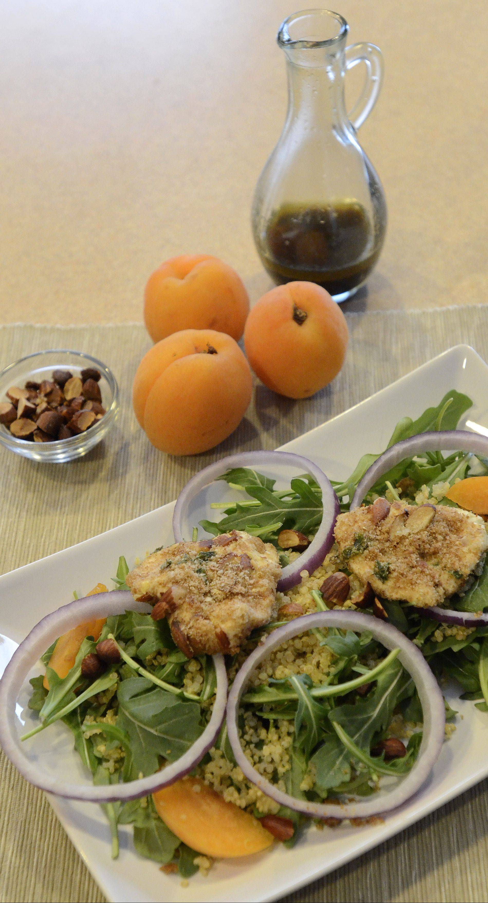 Spring Arugula Salad gets an antioxidant boost from sliced apricots and almond-crusted goat cheese.