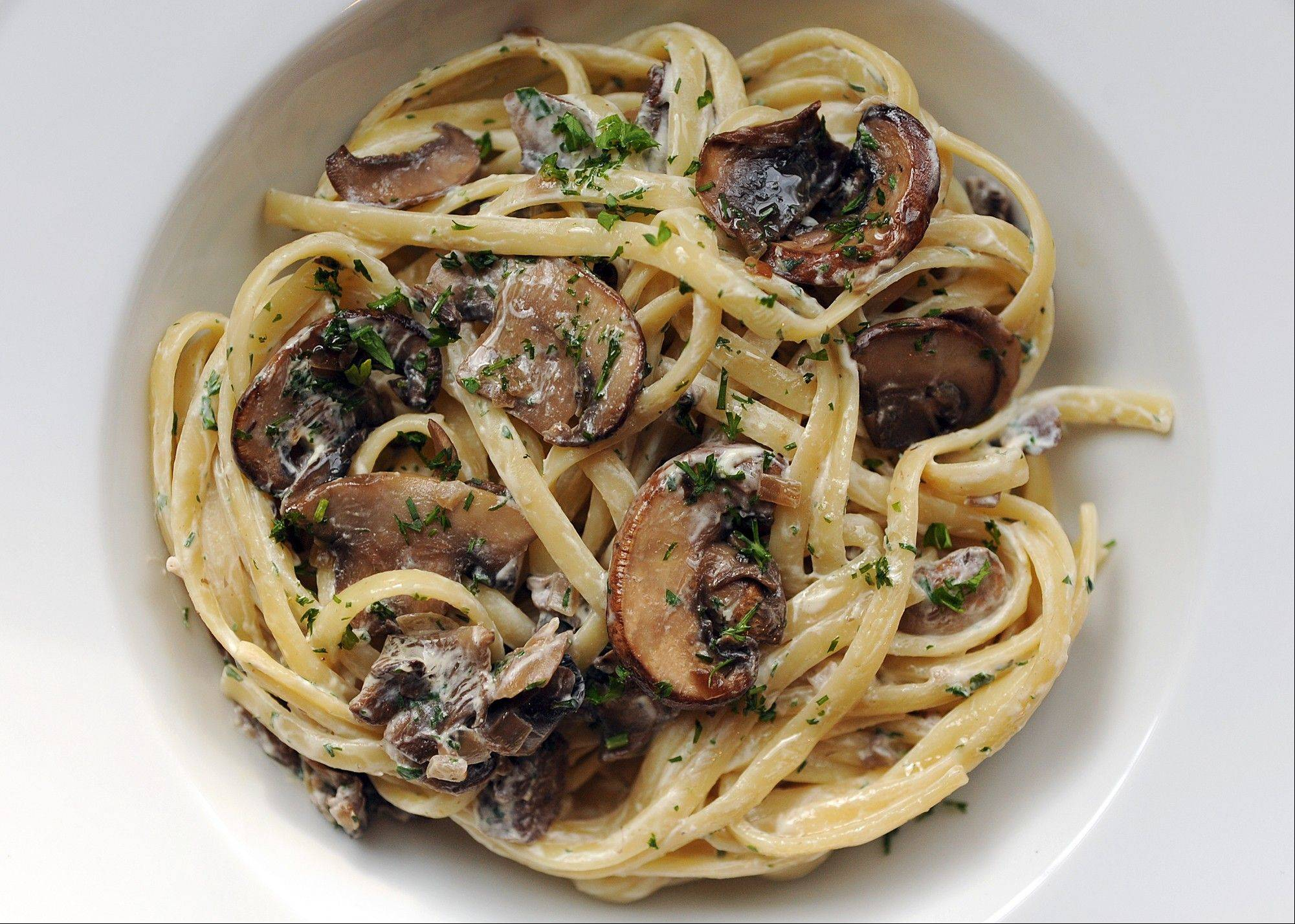 Linguine With Mushrooms Stroganoff Style updates the classic beef stroganoff by adjusting the sour cream and ditching the meat.