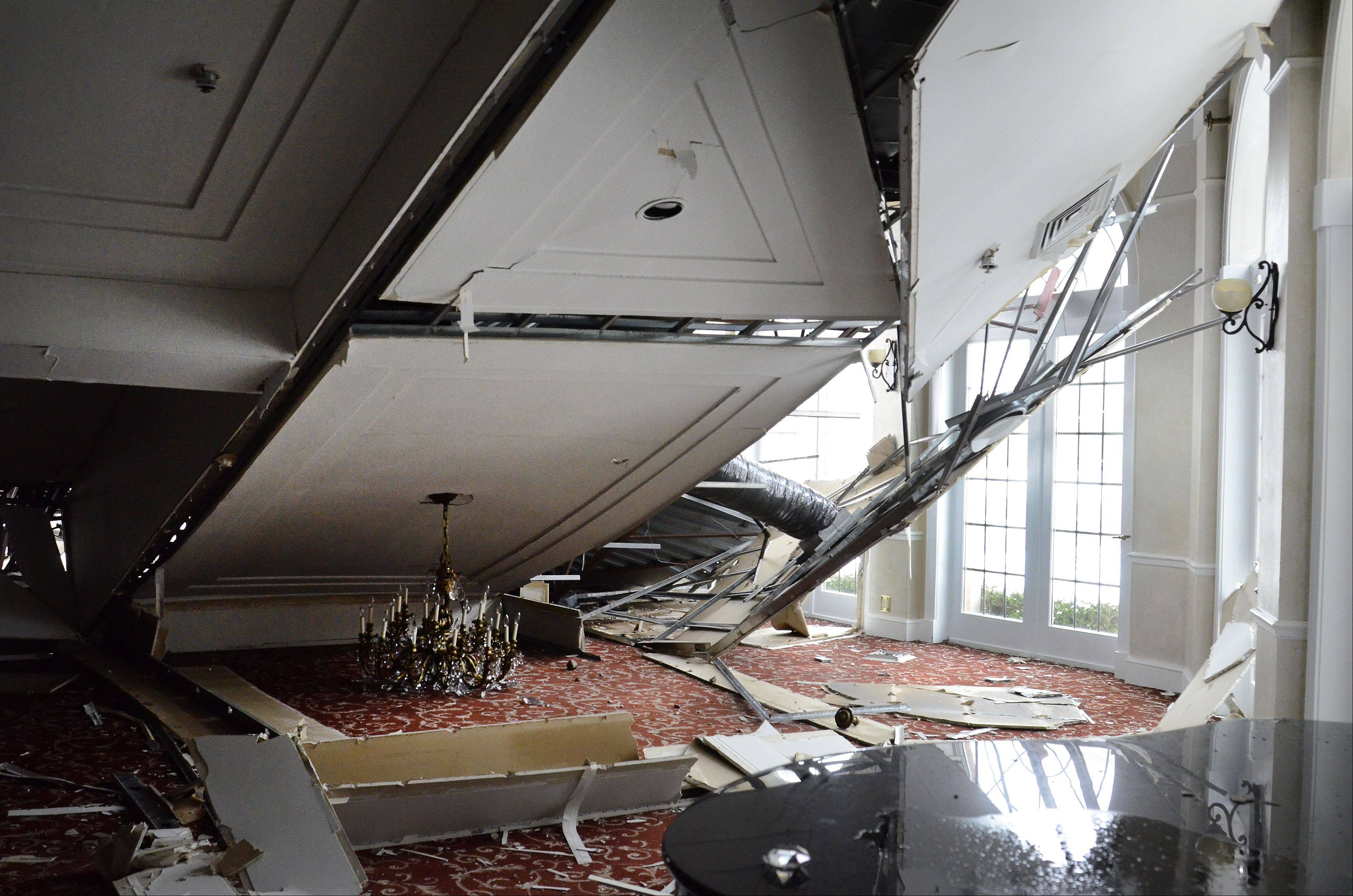 Authorities suspect a buildup of snow from Tuesday�s winter storm caused the roof to collapse over a portion of Cafe la Cave in Des Plaines. The collapse destroyed one ballroom and damaged other portions of the banquet hall and restaurant.