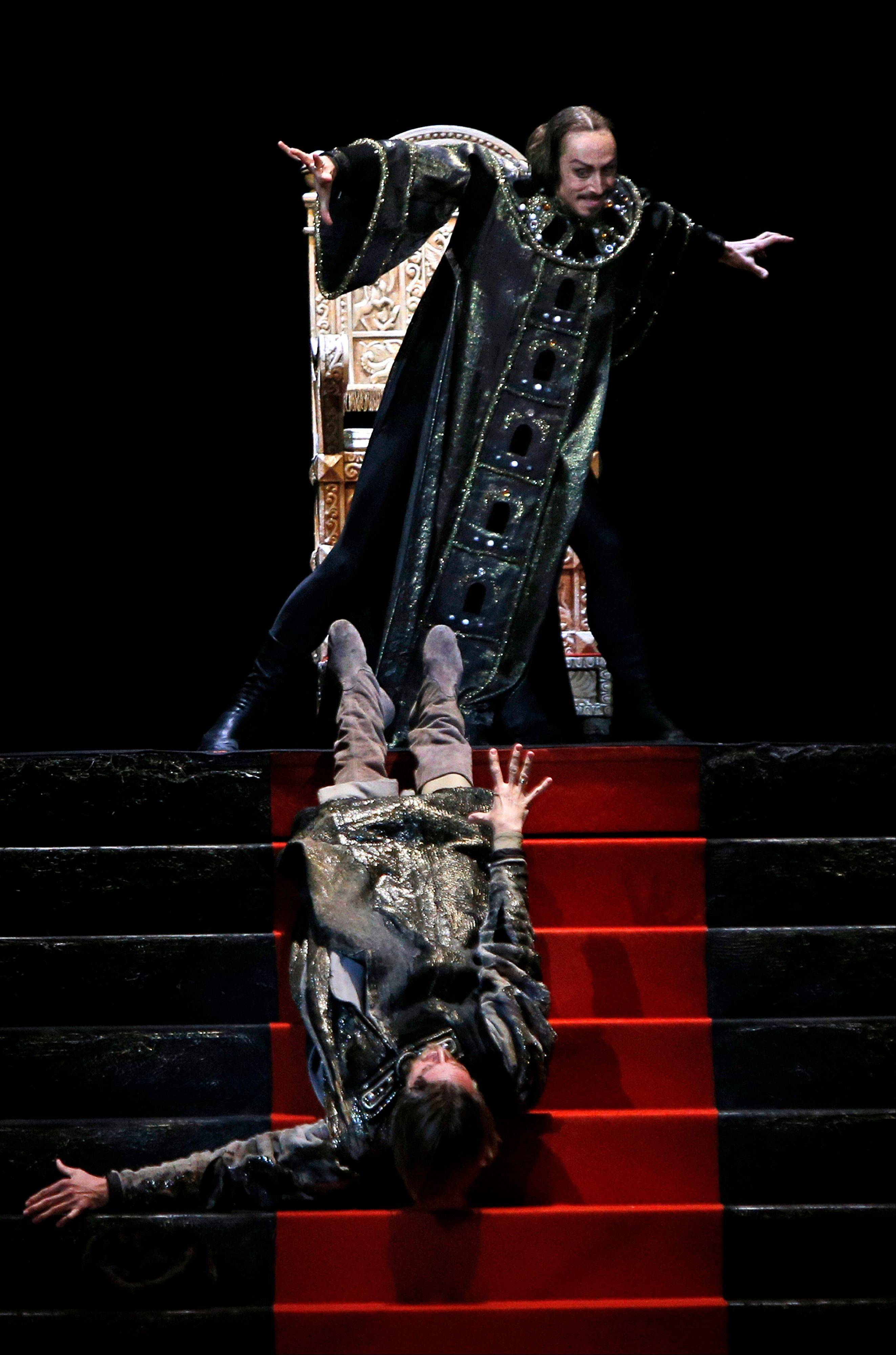 In this Nov. 4, 2012 photo Russian dancer Pavel Dmitrichenko as Ivan the Terrible, top, performs at a dress rehearsal of Ivan the Terrible in the Bolshoi Theater in Moscow, Russia. Three men are detained for an acid attack that severely burned the face and eyes of Bolshoi ballet director Sergei Filin.