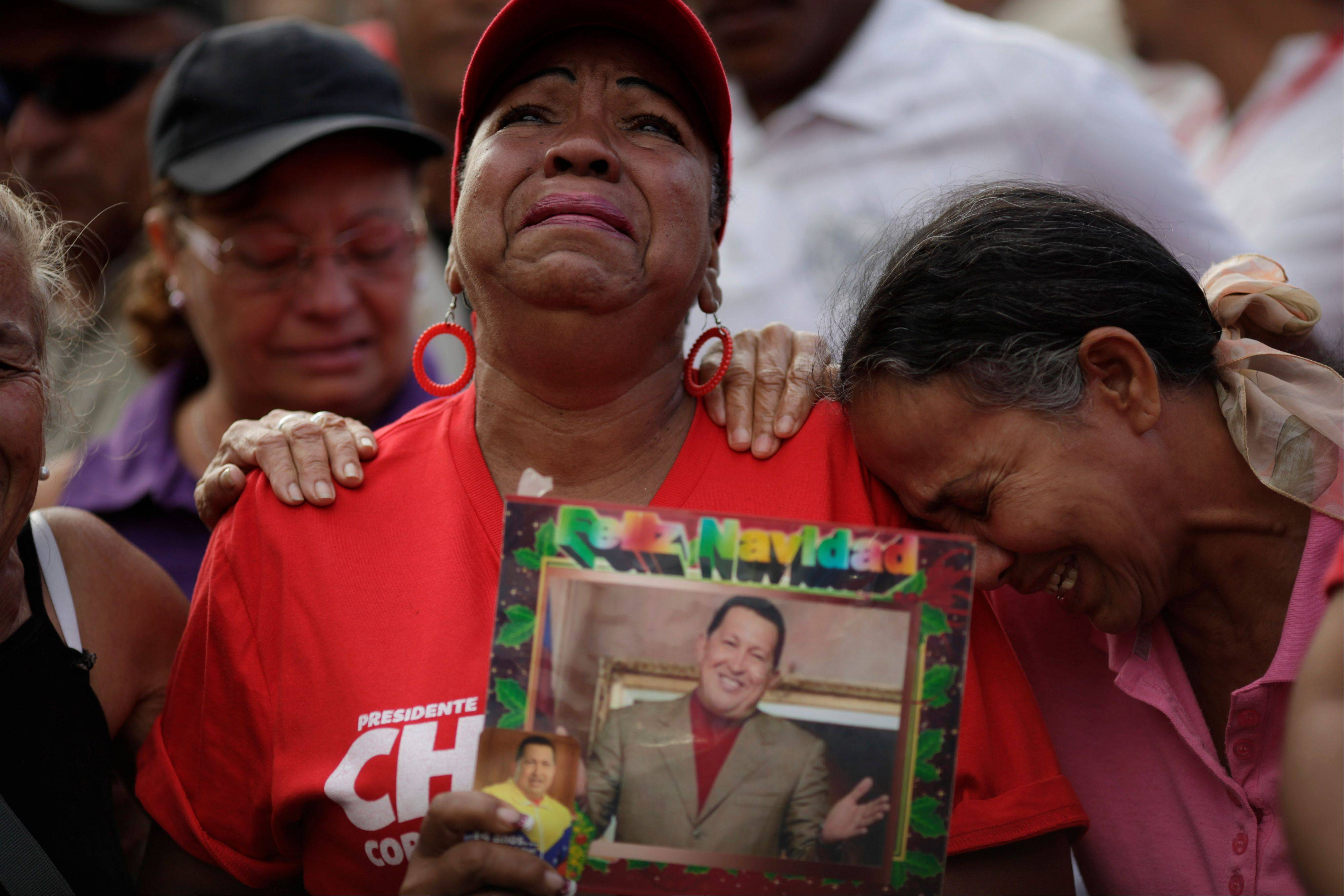 Supporters of Venezuela's President Hugo Chavez cry outside the military hospital where President Hugo Chavez, aged 58, died Tuesday in Caracas, Venezuela, Wednesday.