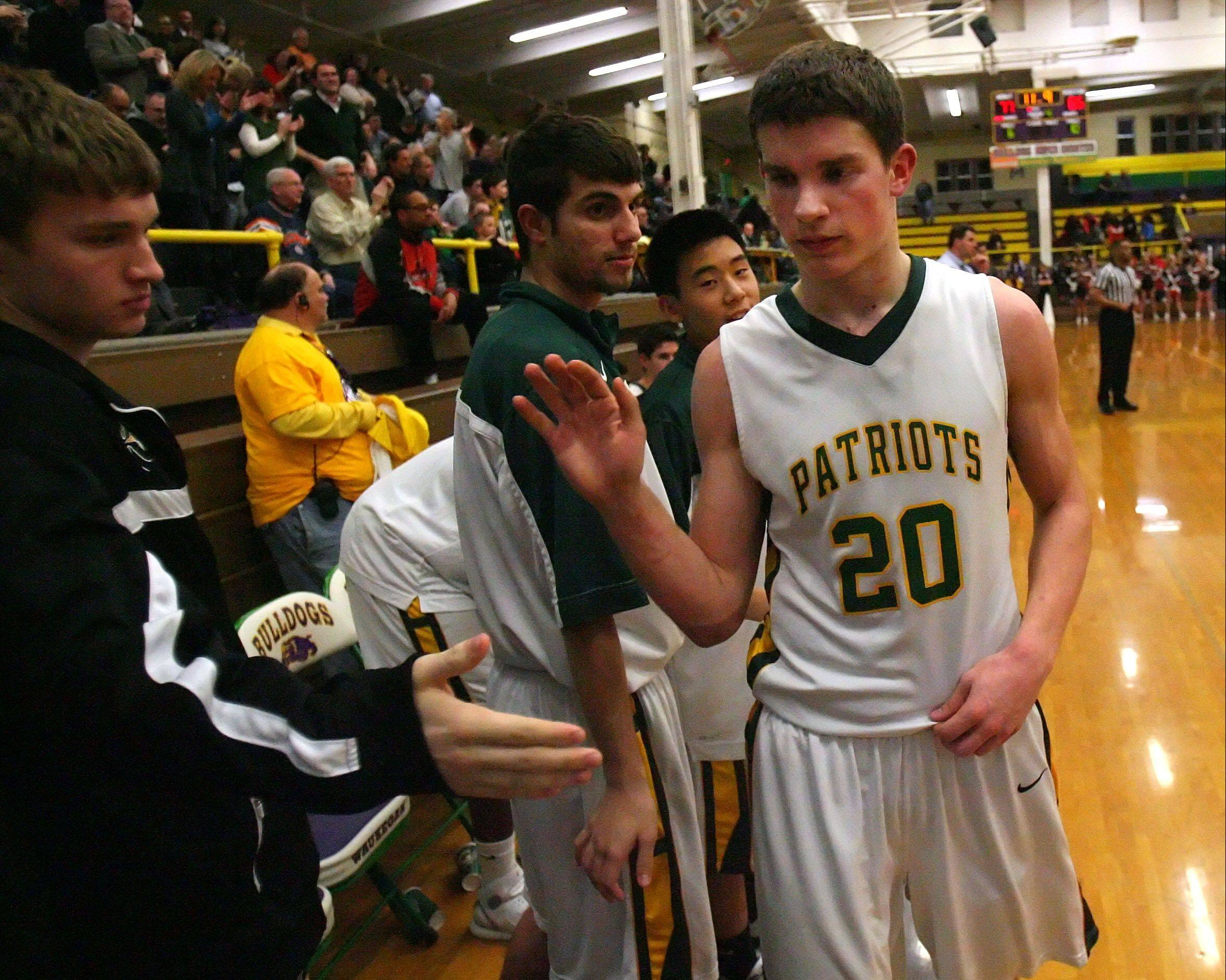 Stevenson's Matt Morrissey gets high-fives from the bench during the Patriots' win over Mundelein in the Class 4A Waukegan sectional semifinals Wednesday night.