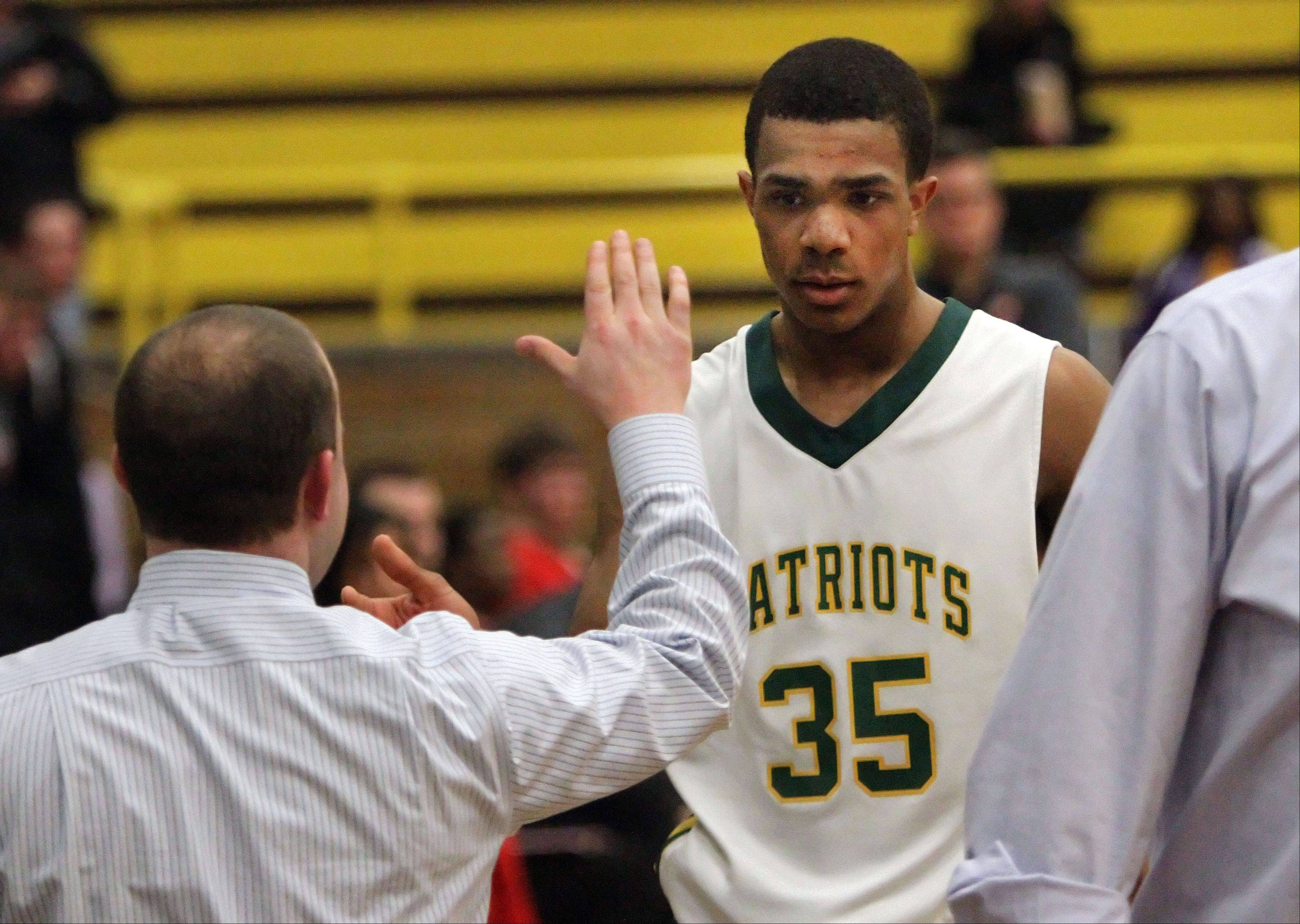 Stevenson's Connor Cashaw gets high-fives from the bench during their win over Mundelein.