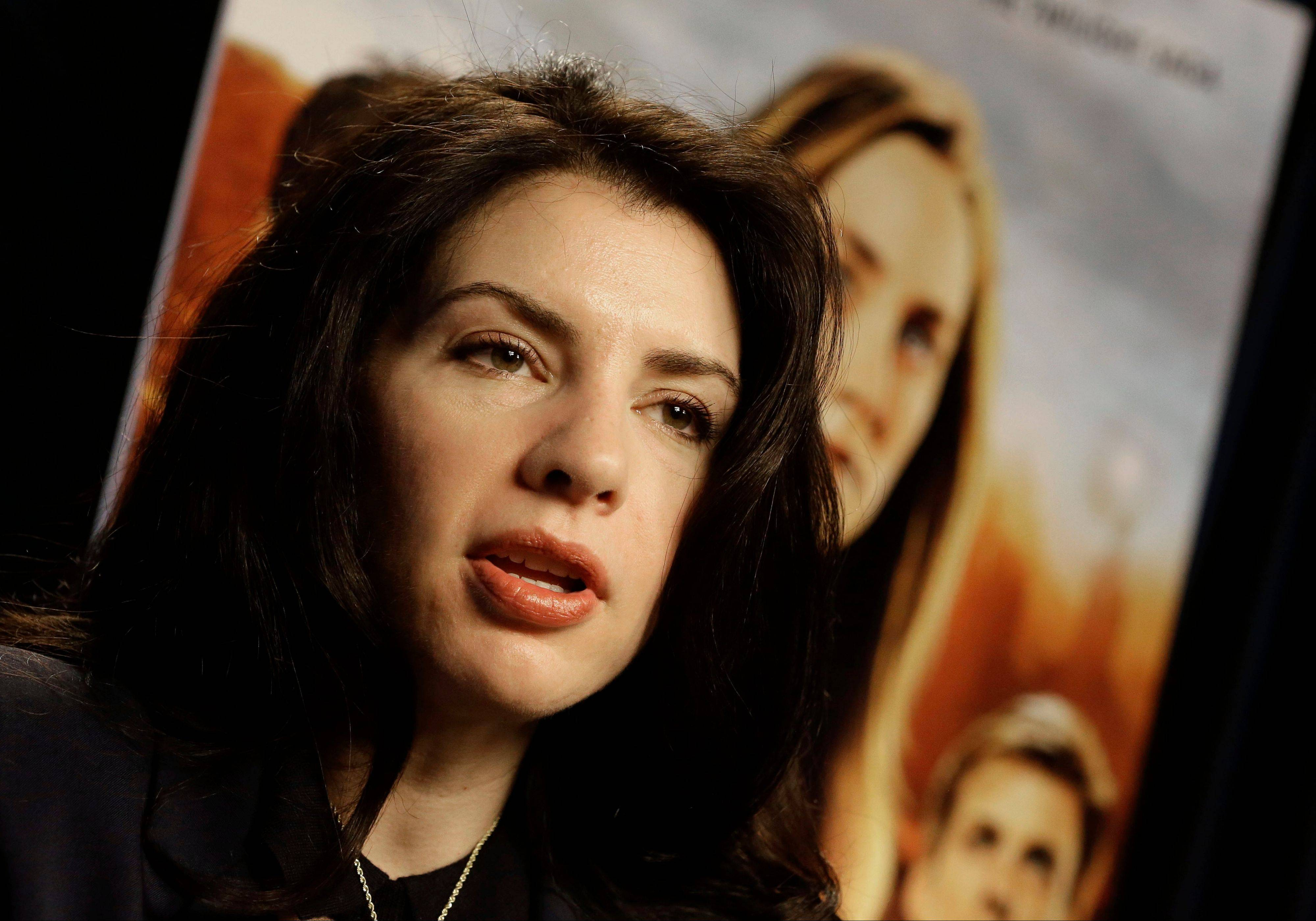"Stephenie Meyer says she wrote ""The Host"" as an escape from editing of one of the books in her popular vampire series. She will be signing books on Monday, March 11, at Anderson's Bookshop in Naperville."
