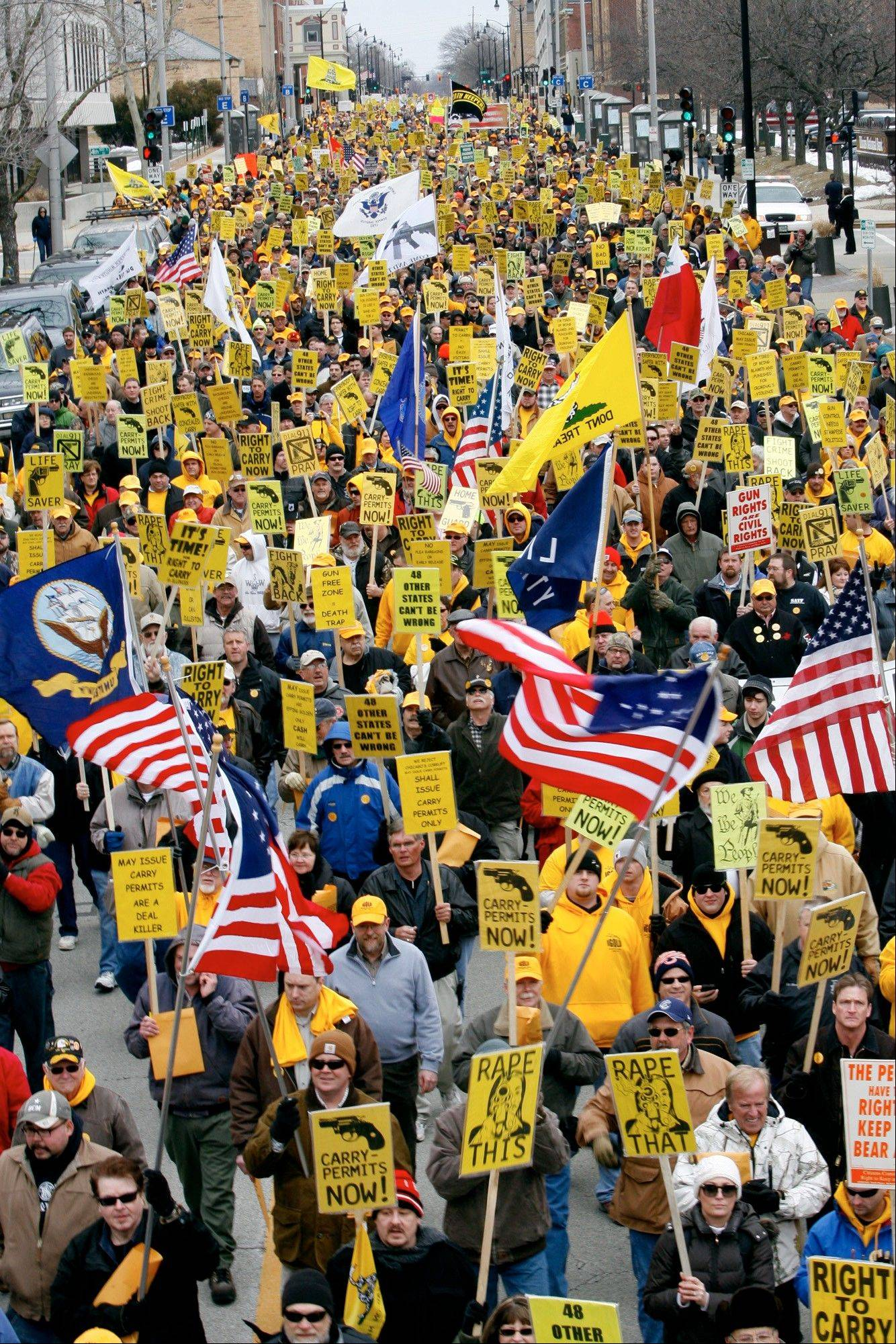 Hundreds of gun owners and supporters march down Capitol Avenue during the annual Illinois Gun Owners Lobby Day Wednesday in Springfield. The Illinois State Rifle Association, in partnership with IllinoisCarry.com and other groups, including the McHenry County Right to Carry Association, organized the event.