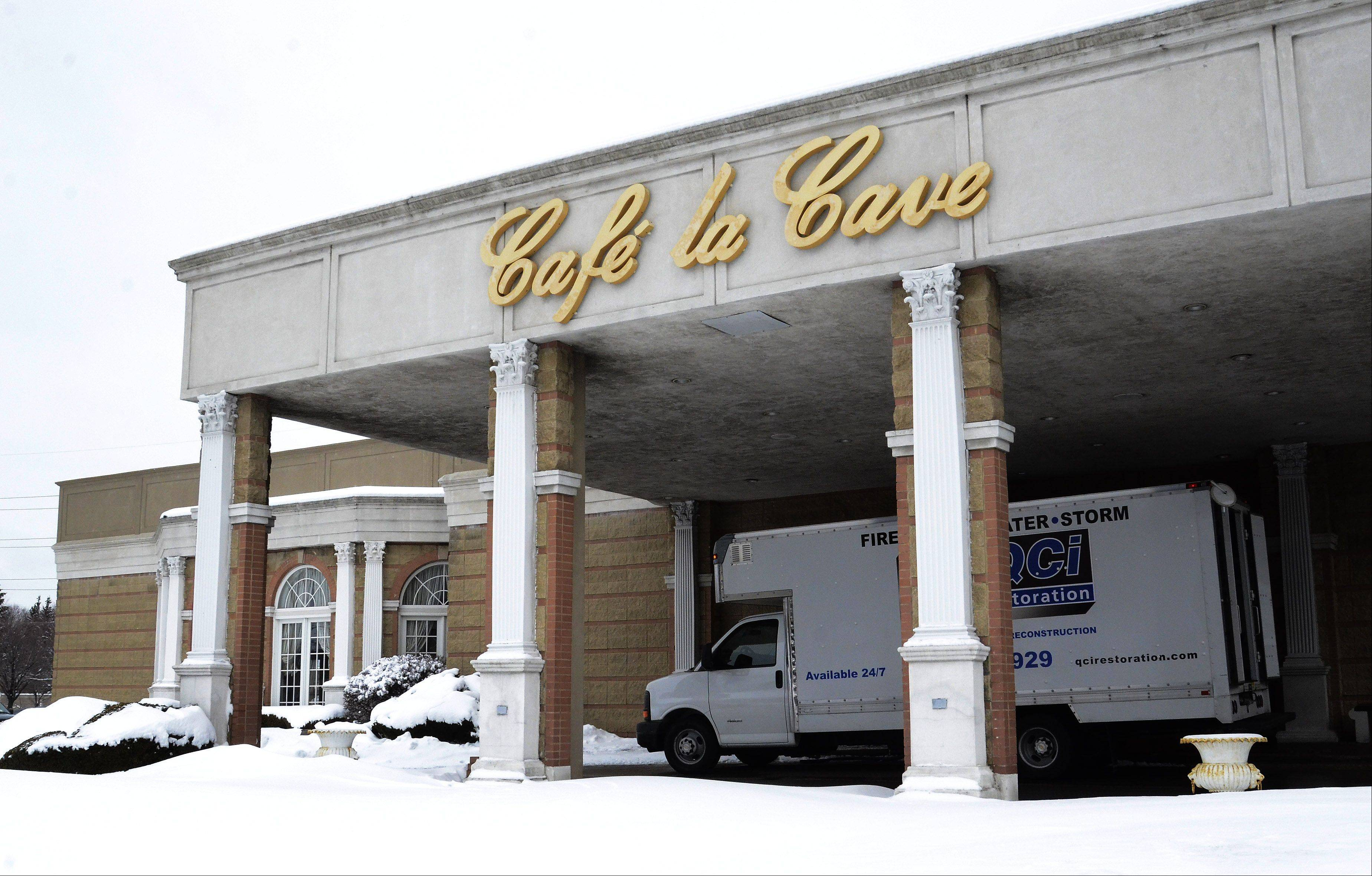 Authorities suspect a buildup of snow from Tuesday's winter storm caused the roof to collapse over a portion of Cafe la Cave in Des Plaines. The collapse destroyed one ballroom and damaged other portions of the banquet hall and restaurant.