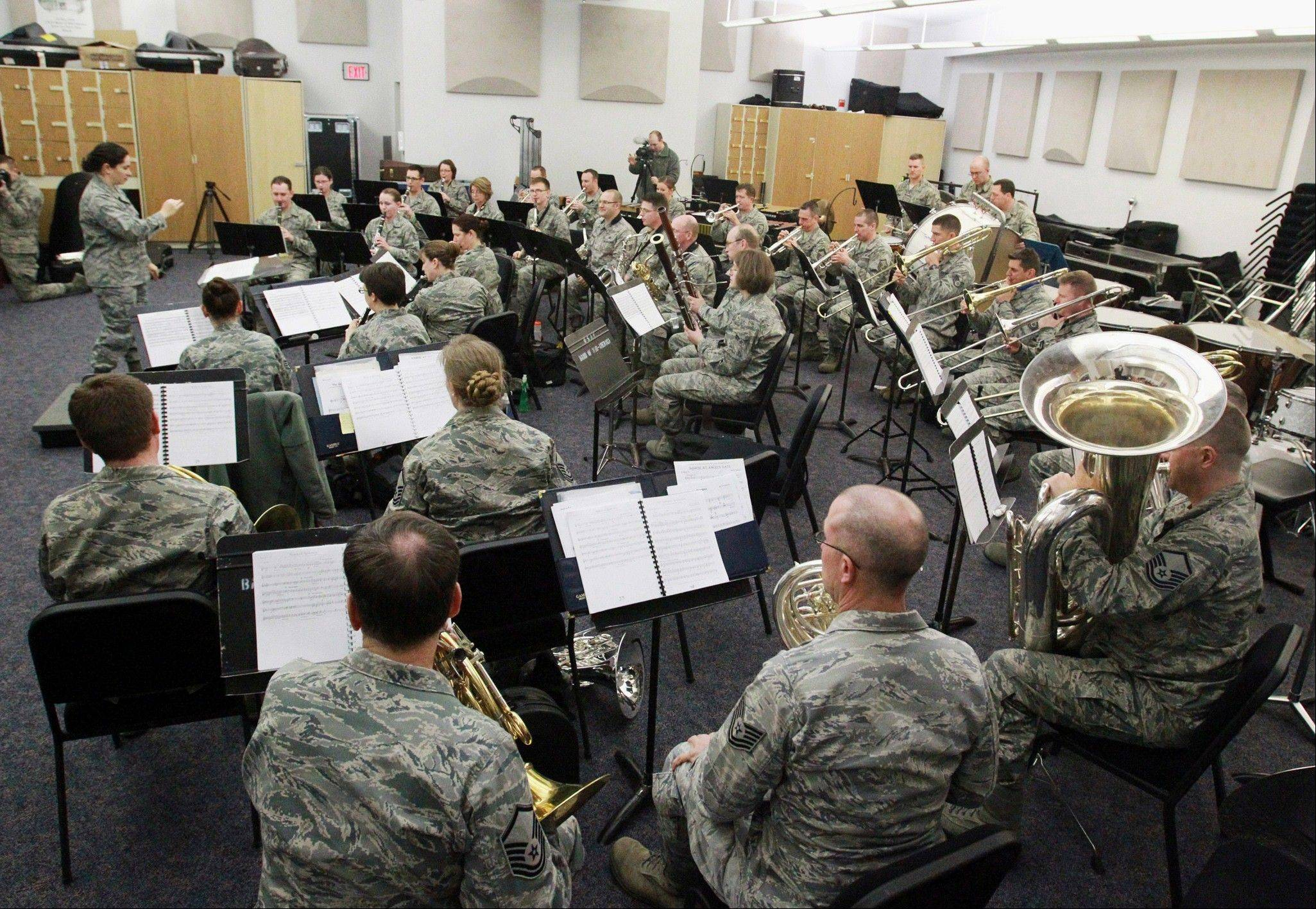 The U.S. Air Force Band of Mid-America under the direction of Maj. Cristina Moore Urrutia perform for special guest Robert Geggie at Scott Air Force Base, Ill.