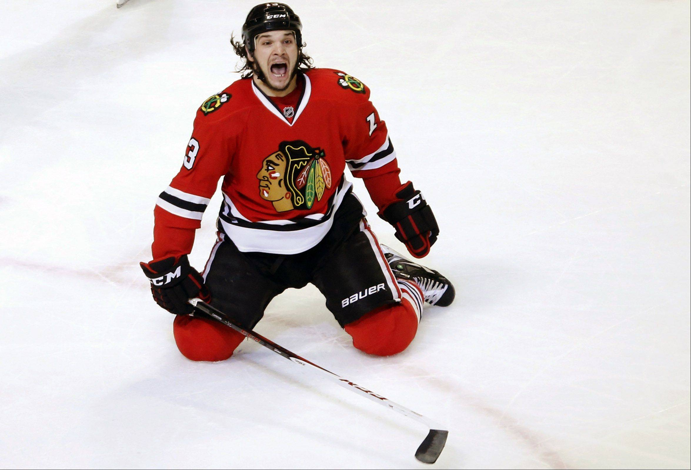 Chicago Blackhawks left wing Daniel Carcillo celebrates his winning goal.