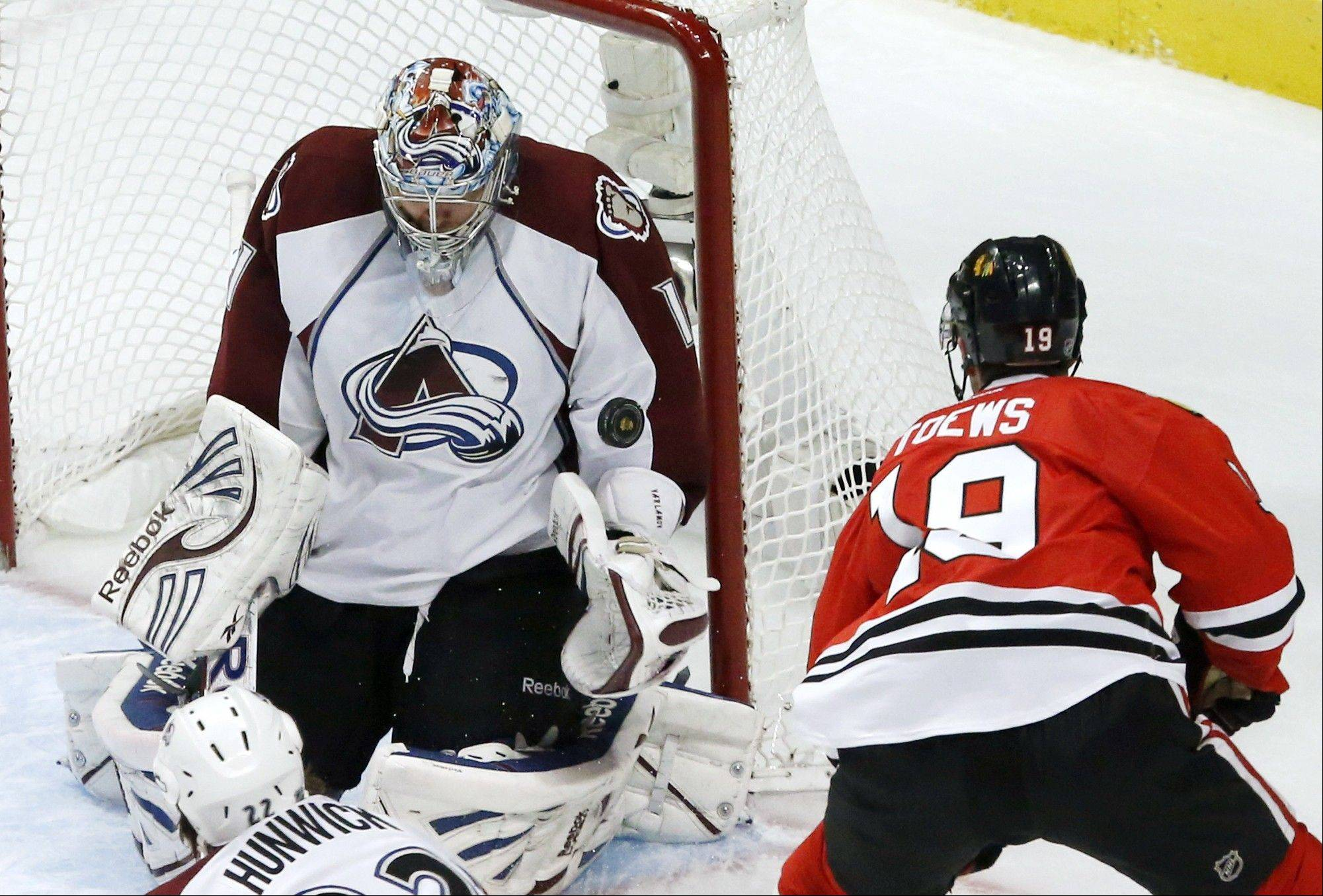 Colorado Avalanche goalie Semyon Varlamov makes a save on a shot by Chicago Blackhawks center Jonathan Toews during the second period.