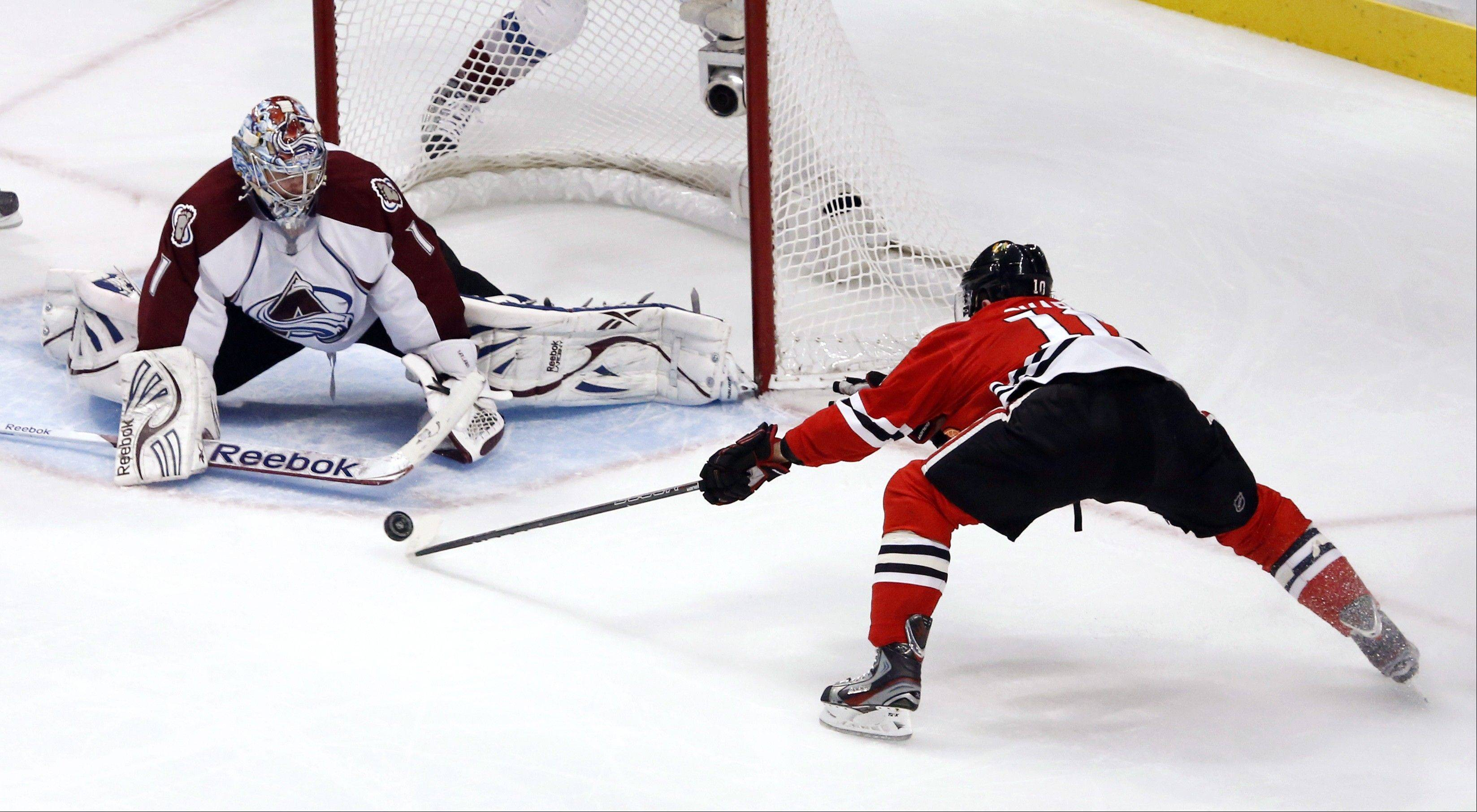 Chicago Blackhawks center Patrick Sharp, right, is unable to get the rebound off a shot on Colorado Avalanche goalie Semyon Varlamov during the second period.