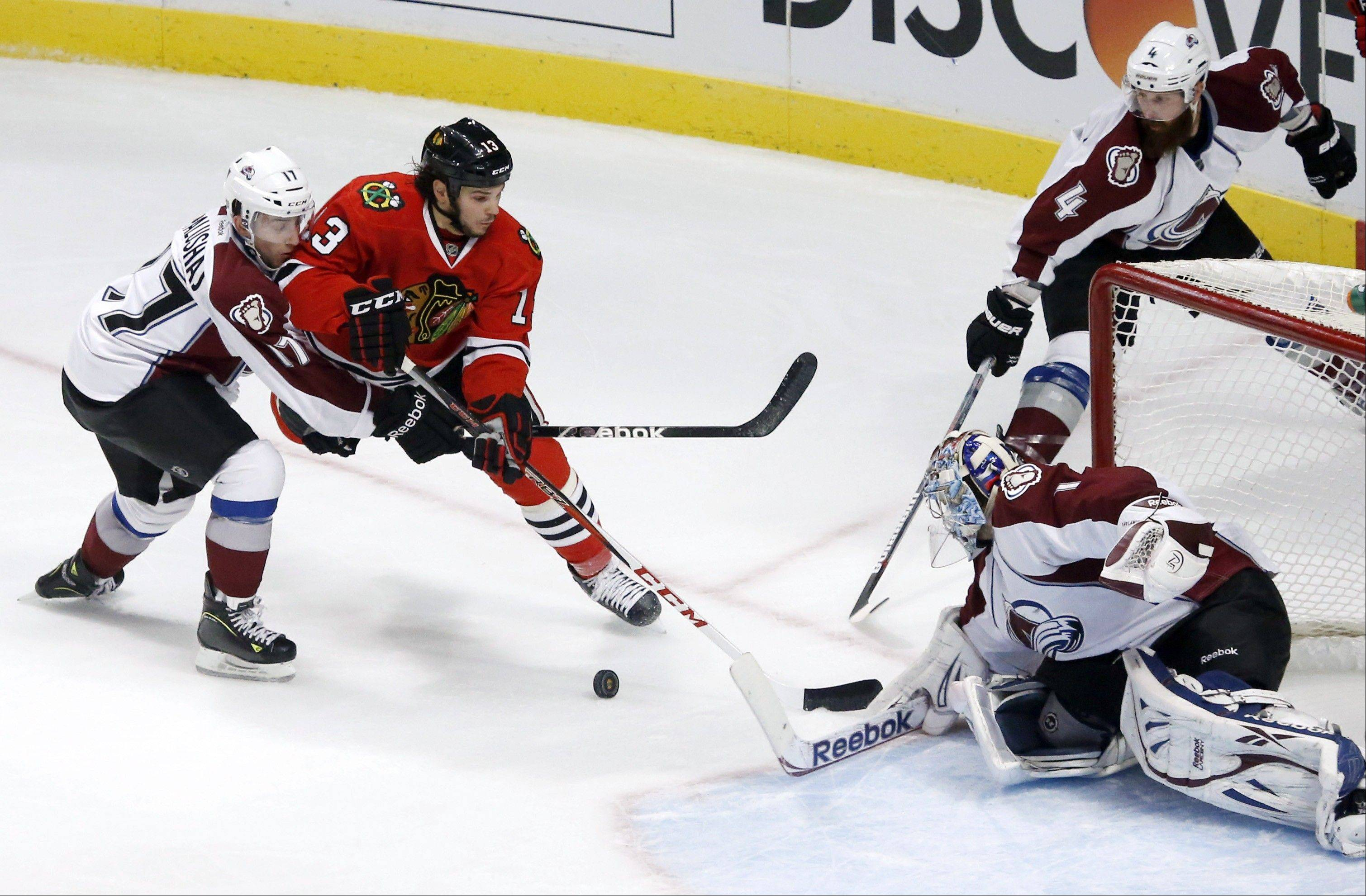 Chicago Blackhawks left wing Daniel Carcillo is unable to get a rebound off his shot on Colorado Avalanche goalie Semyon Varlamov as Aaron Palushaj and Greg Zanon defend during the second period .