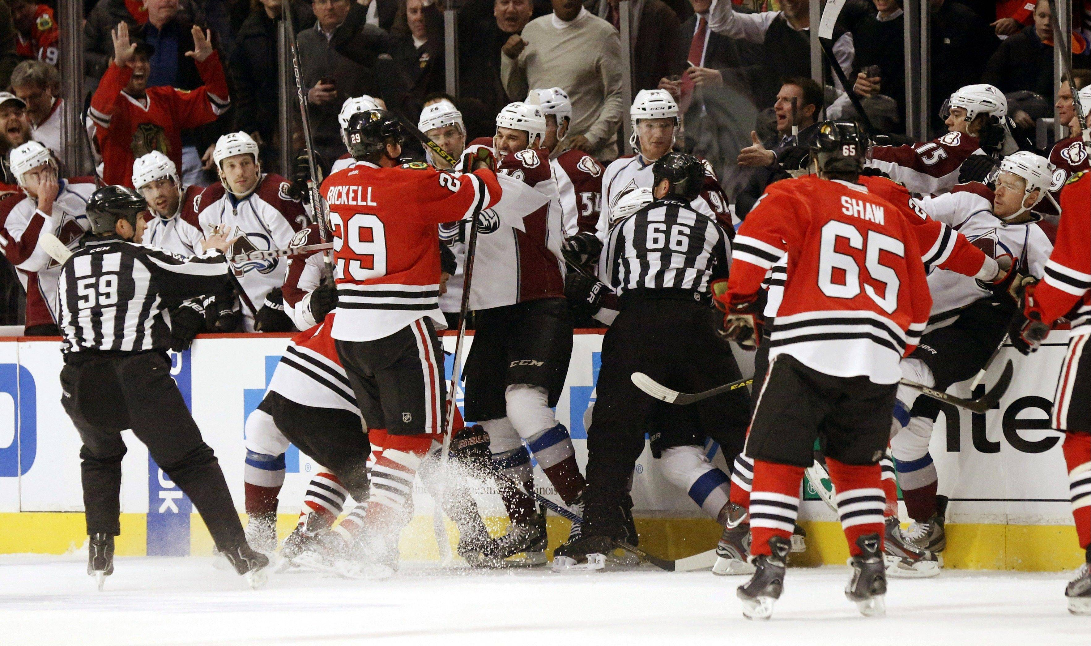 A scuffle breaks out between the Chicago Blackhawks and the Colorado Avalanche in front of the Avalanche bench during the first period.