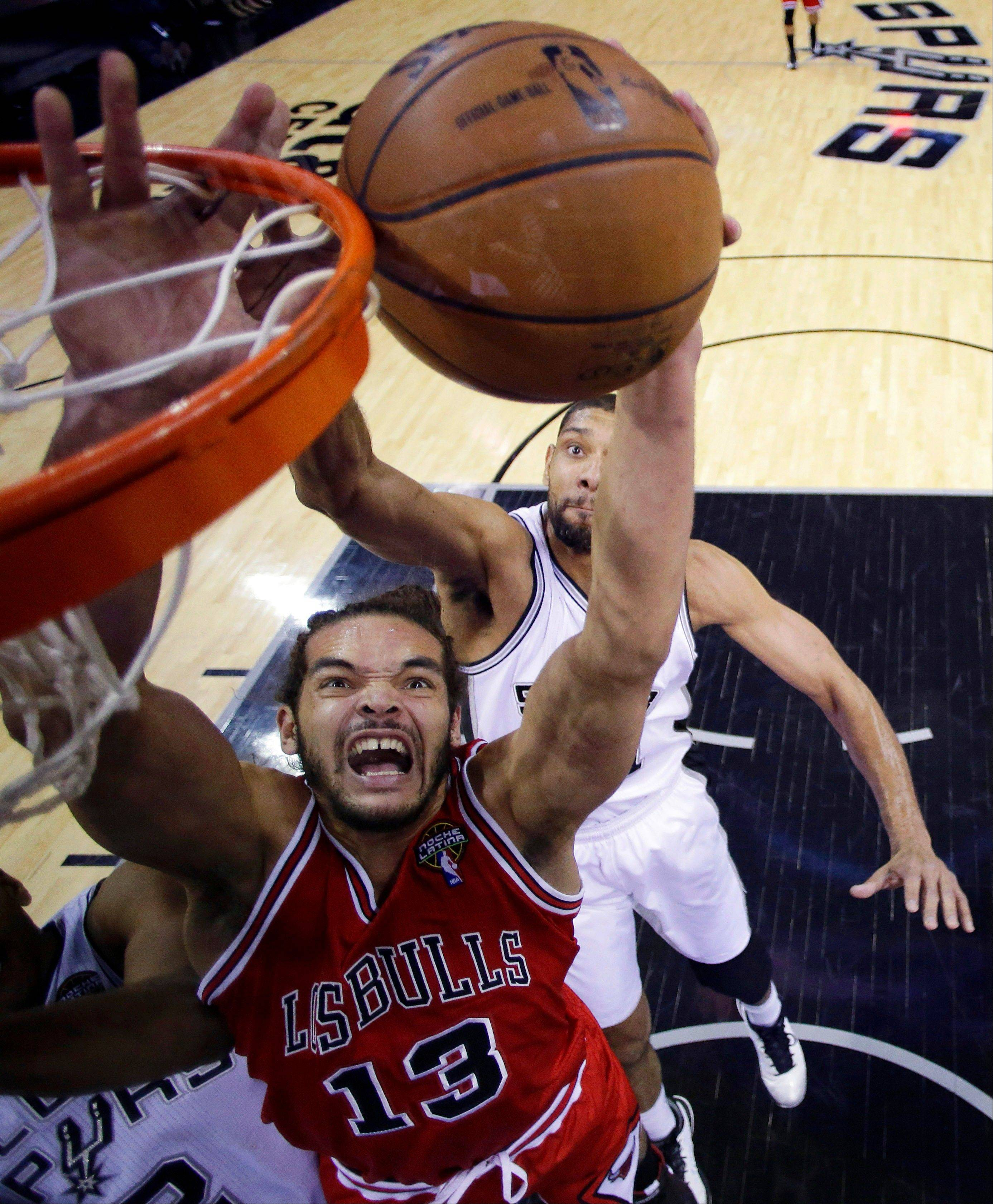 Bulls center Joakim Noah drives to the basket as the Spurs' Tim Duncan defends during the first half Wednesday night.