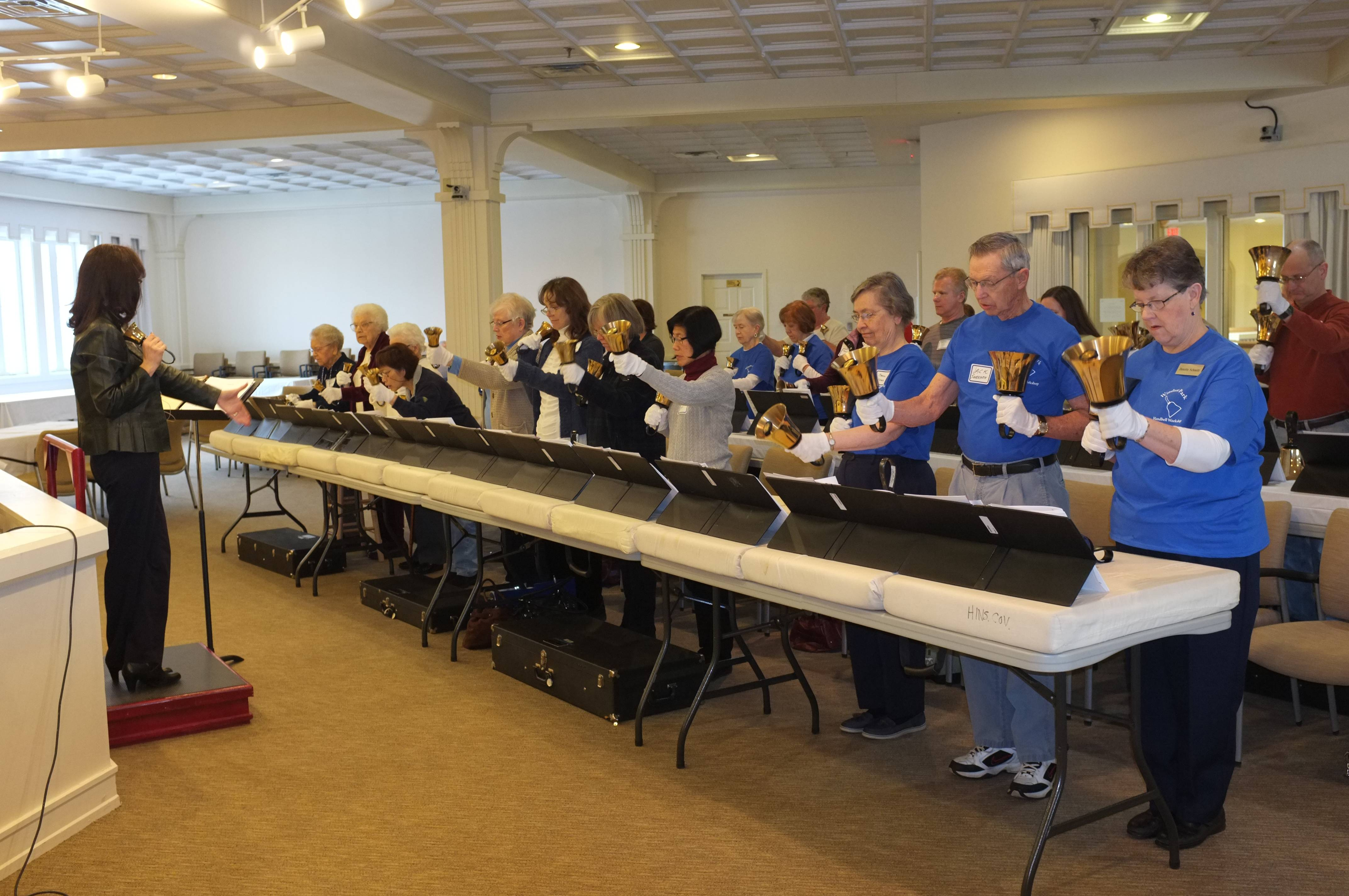 KC Congdon leads handbell ringers at a workshop held on Saturday, March 2. The event was held at Windsor Park, A Covenant Retirement Community in Carol Stream, and drew approximately 30 participants.