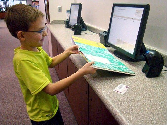 Palatine library officials say their new Express Checkout system is especially popular with children. The system can be found at four locations at the main Palatine Library.