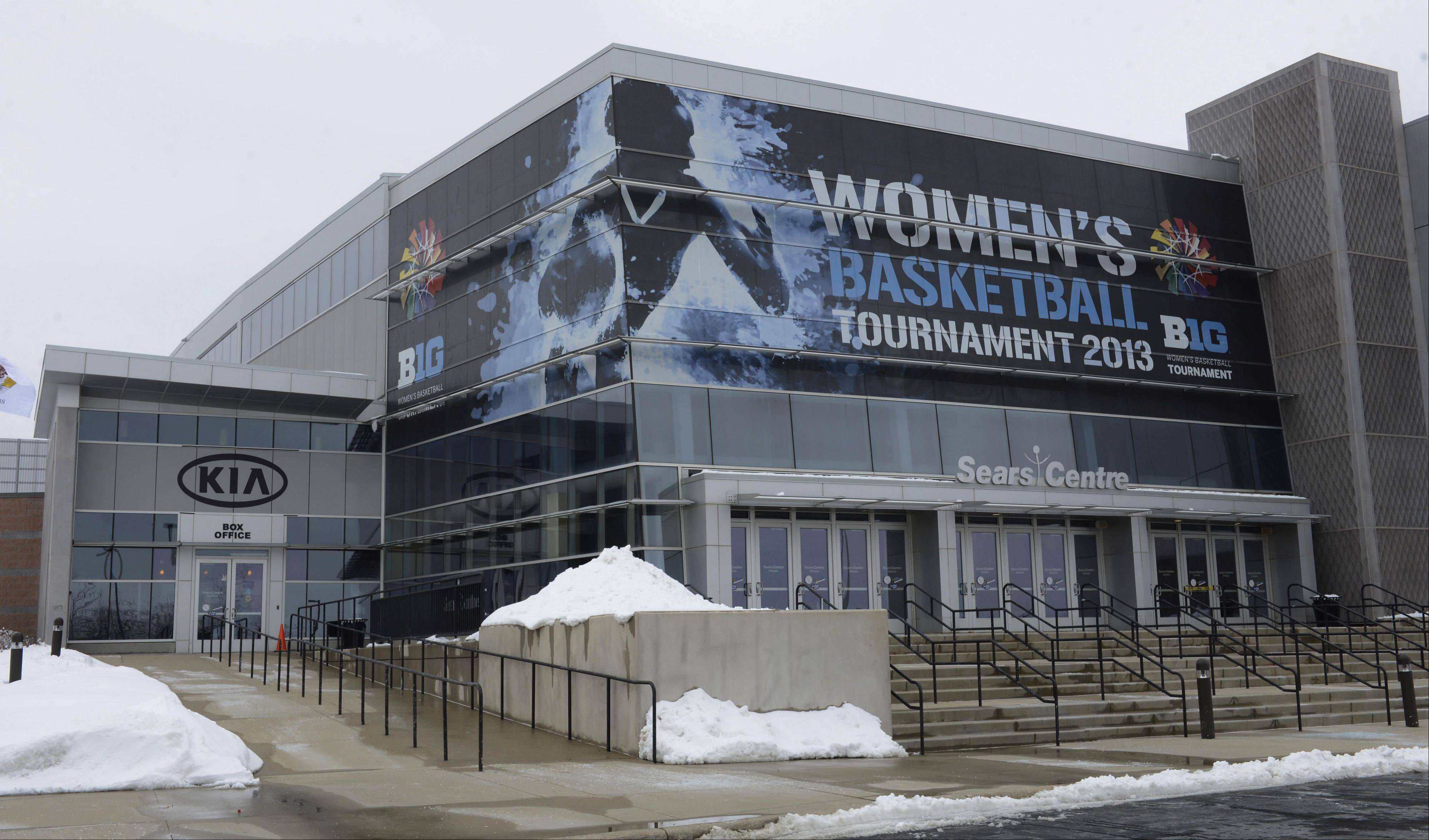 Signs promoting the women's Big Ten basketball tournament, which gets under way Thursday, are displayed at the Sears Centre in Hoffman Estates. Local businesses are expecting to reap economic benefits from the tourney.