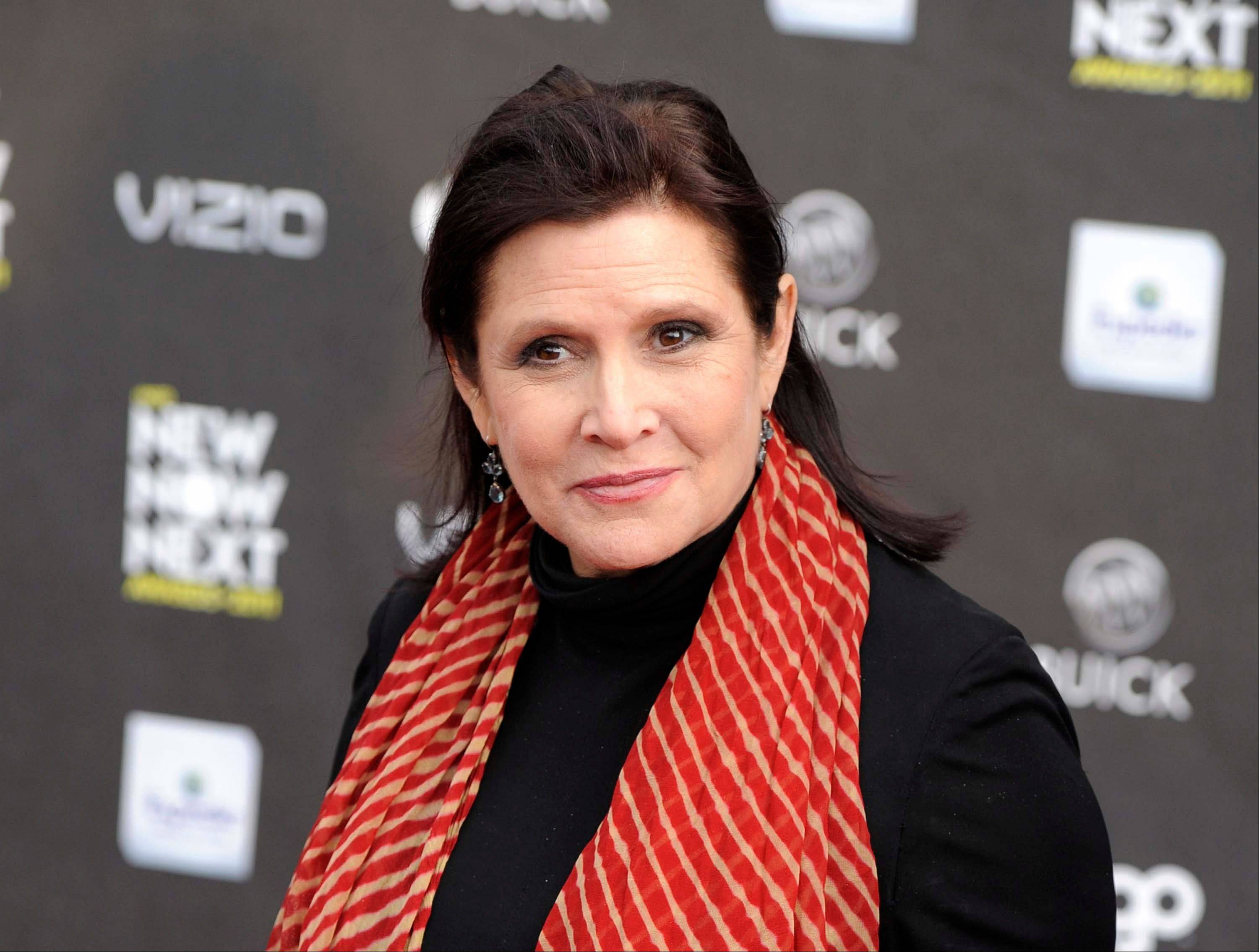 "Carrie Fisher says she's coming back as Princess Leia for the new ""Star Wars"" films."