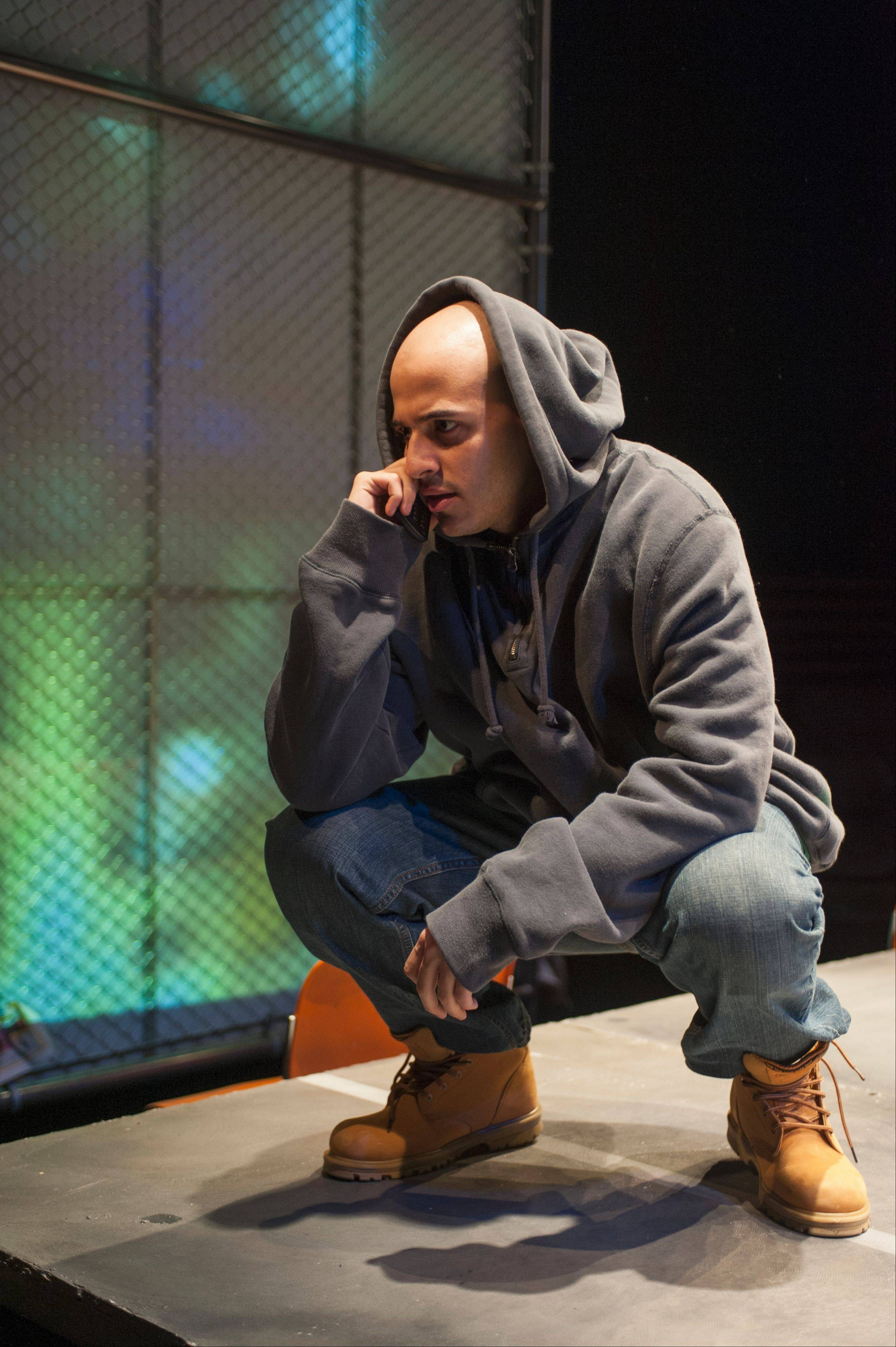 "Jessie David Perez portrays a gang member looking to buy a gun in the Steppenwolf for Young Adults production of ""How Long Will I Cry?: Voices of Youth Violence."""