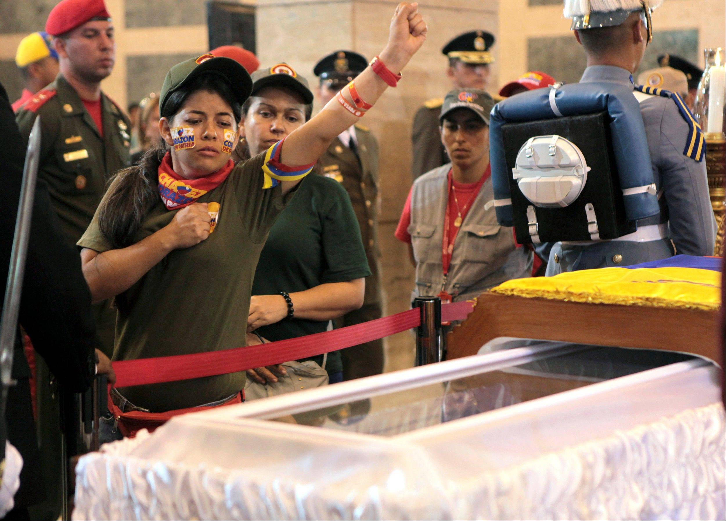 Chavez's body brought 'home' to military academy