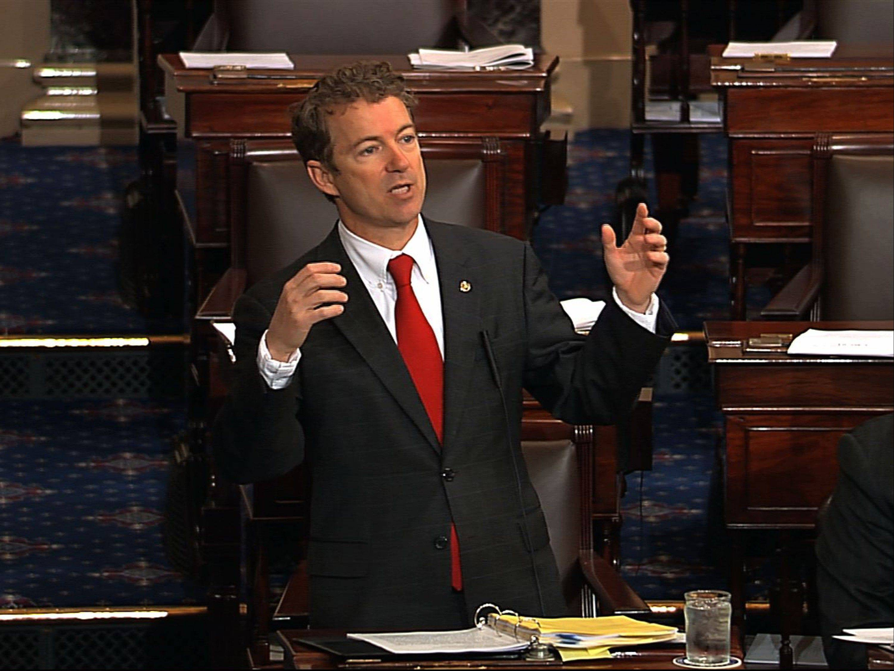 This image provided by Senate Television shows Sen. Rand Paul, a Kentucky Republican, speaking Wednesday on the floor of the Senate in Washington. Senate Democrats had pushed for speedy confirmation of John Brennan�s nomination to be CIA director but ran into a snag after a Paul began a lengthy speech over the legality of potential drone strikes on U.S. soil.