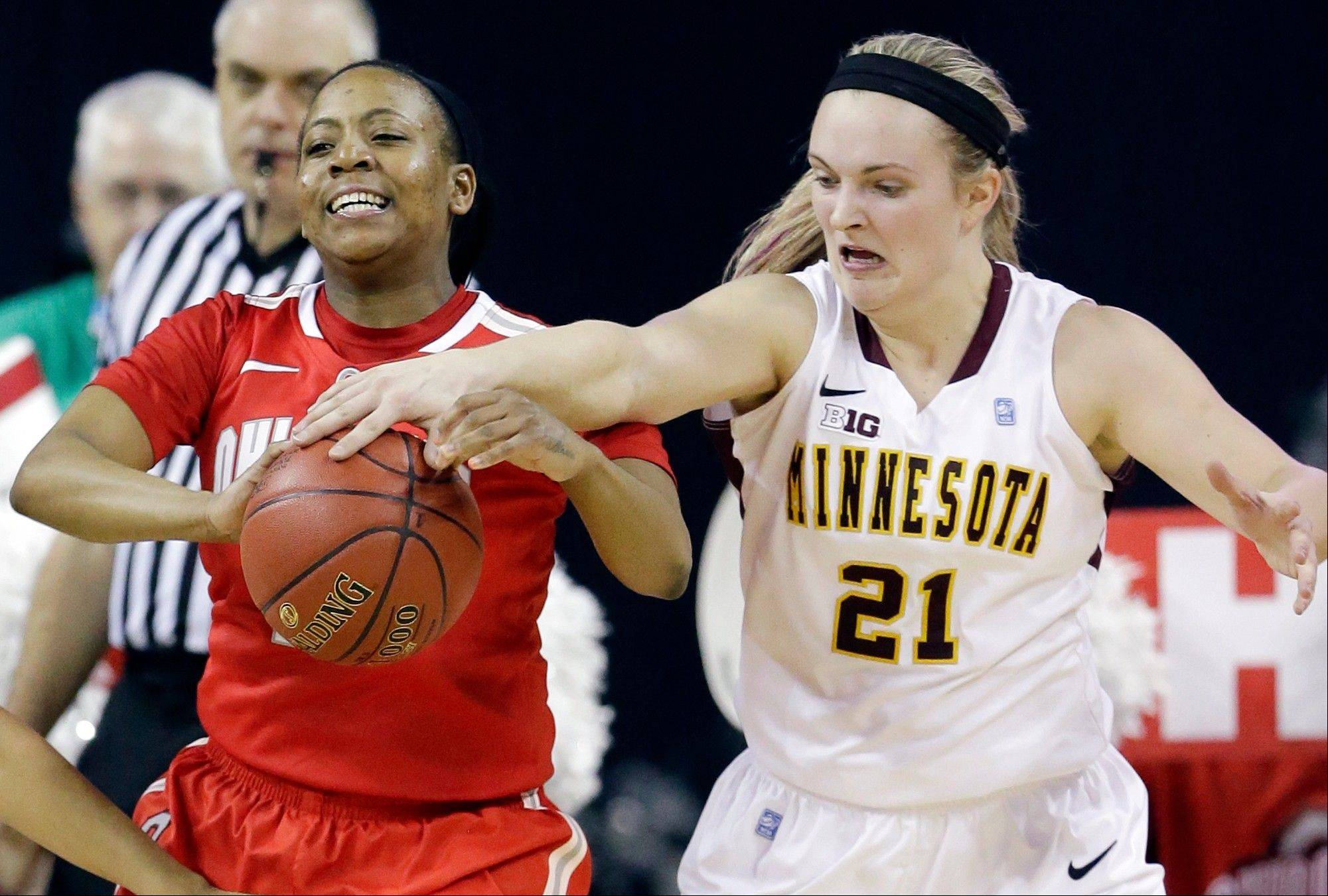 Ohio State guard Ameryst Alston, left, looks to a pass as Minnesota guard Sari Noga guards during the second half of an NCAA college basketball game in the Big Ten Conference women�s tournament in Hoffman Estates Thursday.