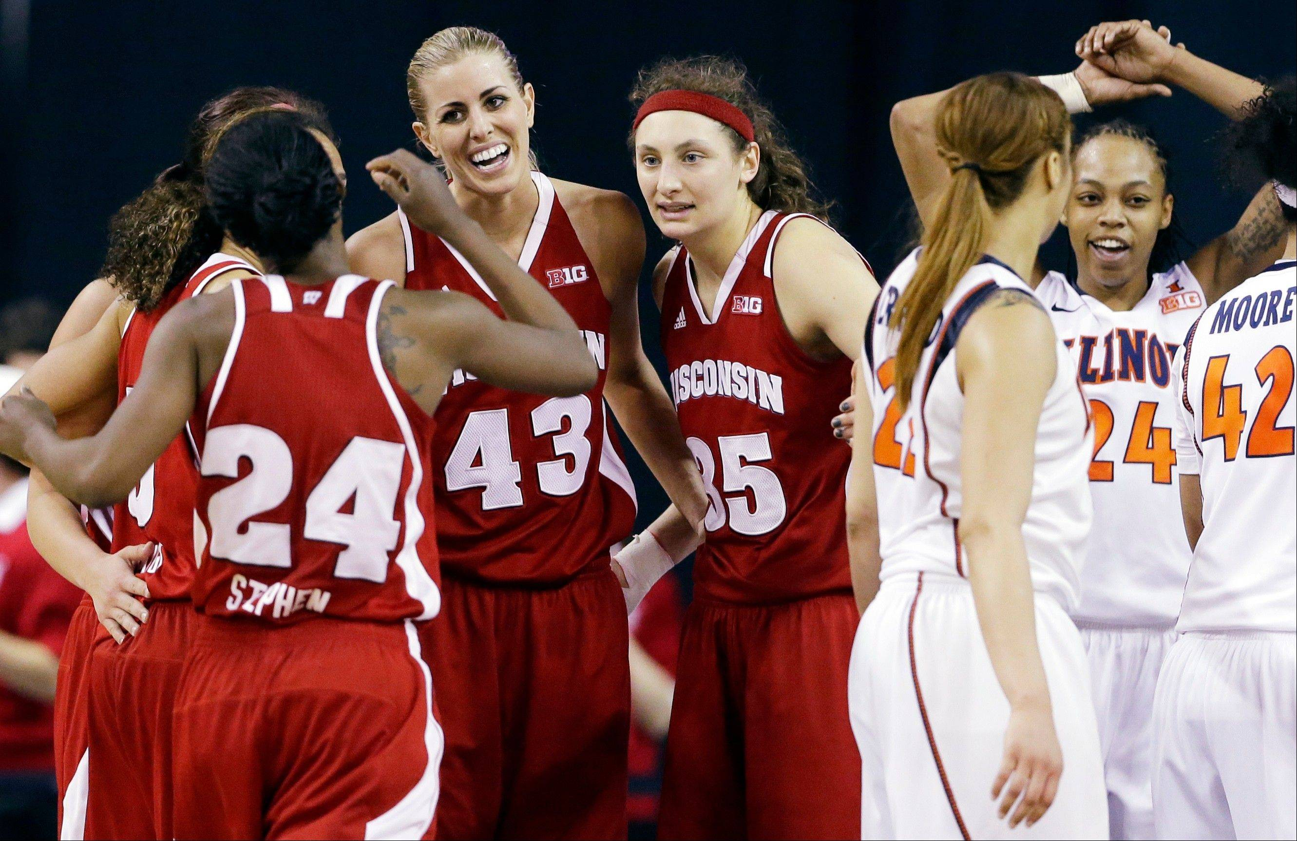 Wisconsin forward Cassie Rochel (43) smiles as she celebrates with guard Tiera Stephen (24) and forward and Bartlett grad Jacki Gulczynski (35) after Illinois guard Adrienne Godbold (24) was called for a foul during the second half of an NCAA college basketball game in the Big Ten Conference tournament in Hoffman Estates, Ill., Thursday, March 7, 2013. Wisconsin won 58-57.