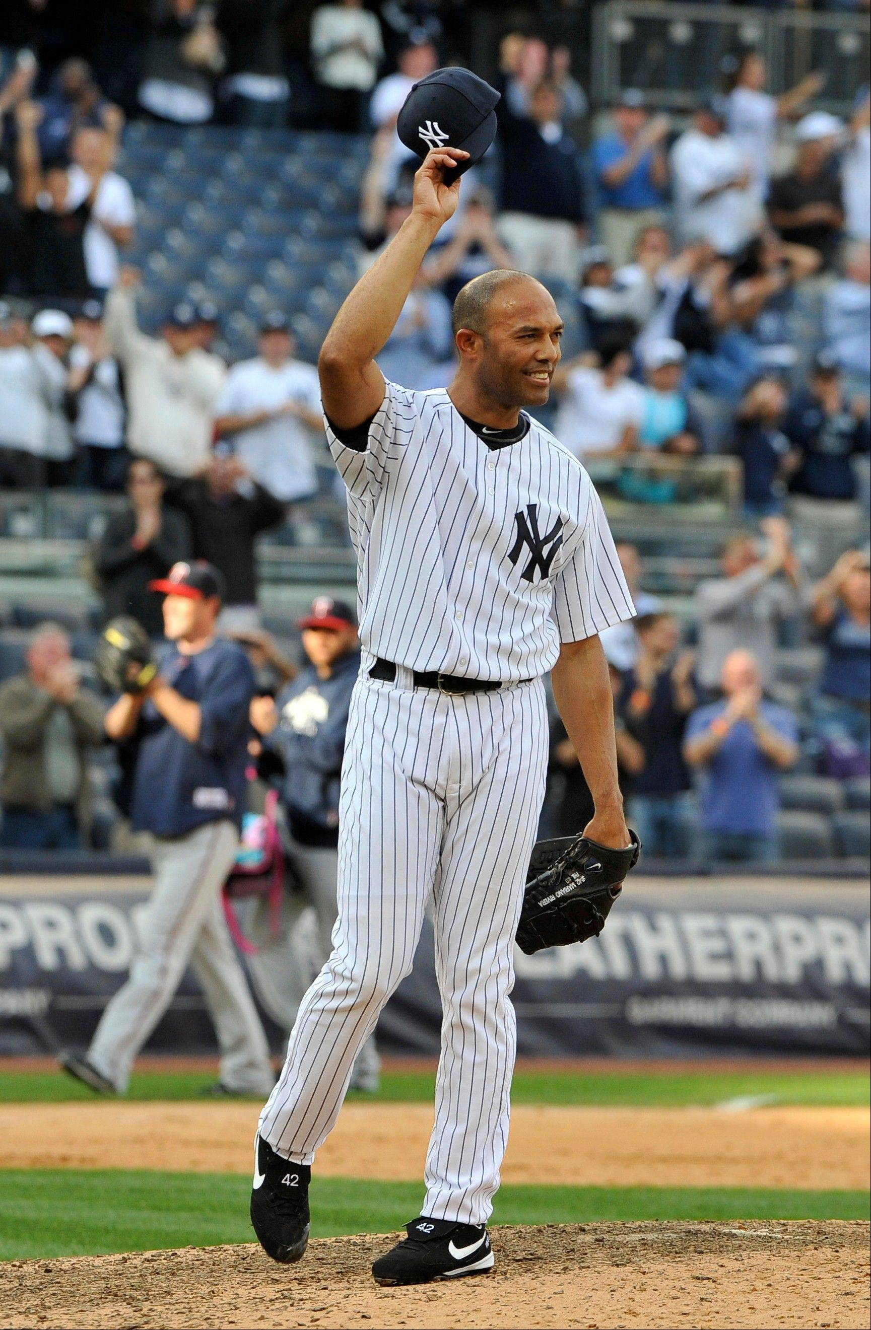 FILE - In this Sept. 19, 2011 file photo, New York Yankees' Mariano Rivera tips his cap to acknowledge the cheers of the crowd after recording his 602nd save as the Yankees beat the Minnesota Twins 6-4 in a baseball game at Yankee Stadium in New York. A person familiar with the decision says that Rivera plans to retire after the 2013 season. The person spoke to The Associated Press on Thursday, March 7, 2013, on condition of anonymity because there had been no official announcement.(AP Photo/Kathy Kmonicek, File)