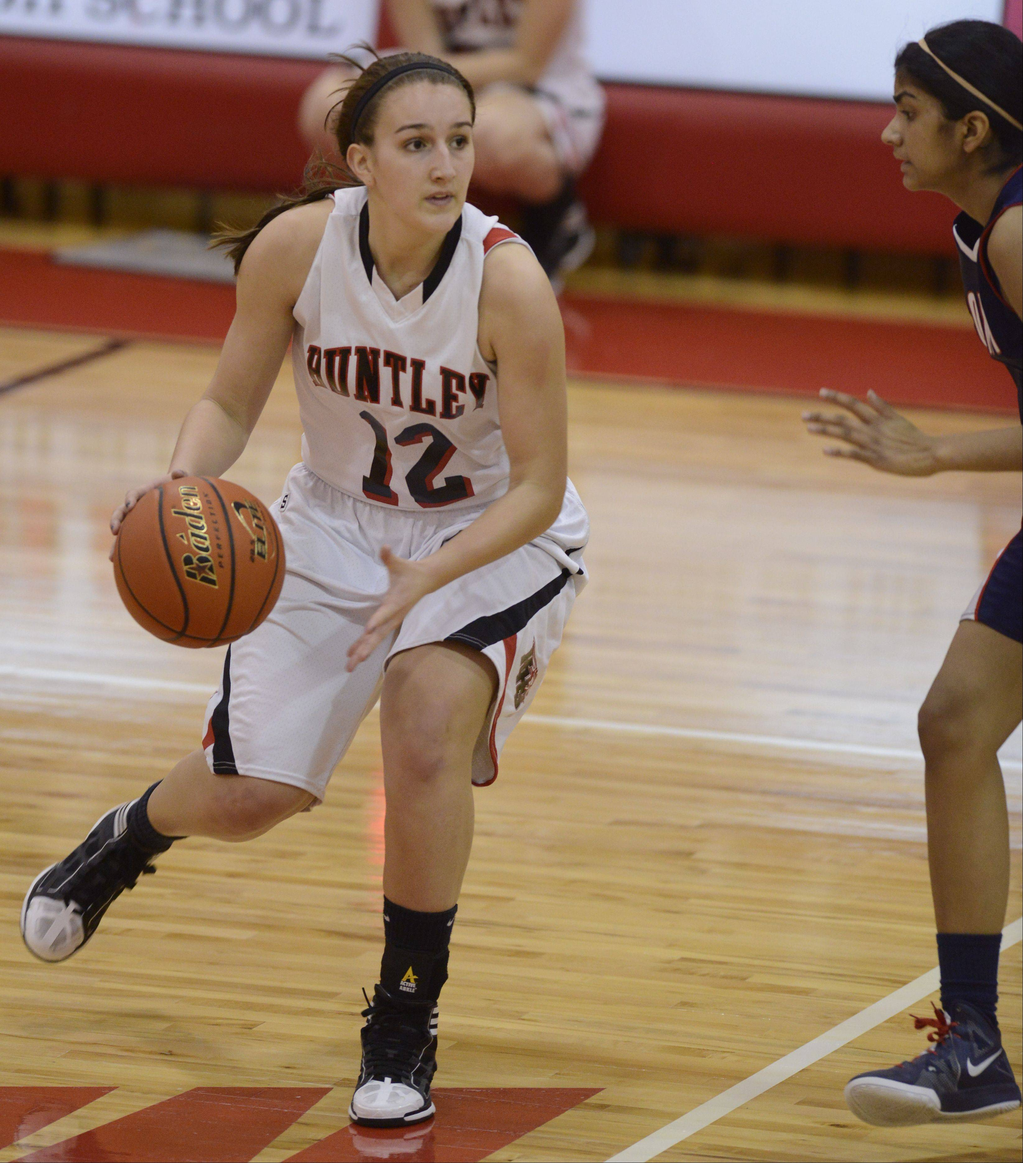 Huntley senior Haley Ream (12) is the honorary co-captain of the 2012-13 Fox Valley all-area girls basketball team.