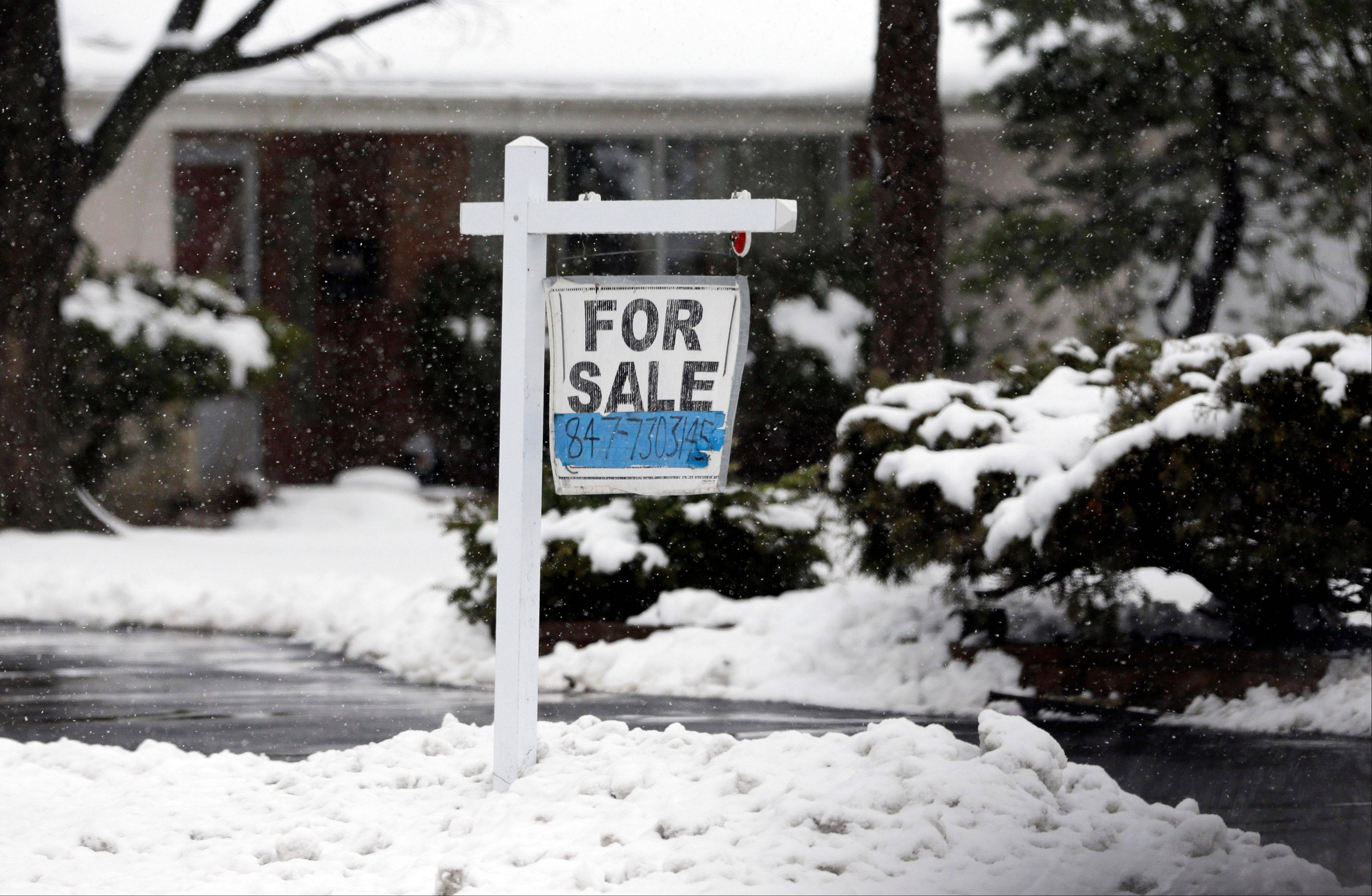 Afor sale sign hangs outside a home in Glenview. Average U.S. rates on fixed mortgages were little changed the first week of March, hovering near historic lows. The lowest mortgage rates in decades have boosted home sales and helped the market rebound.