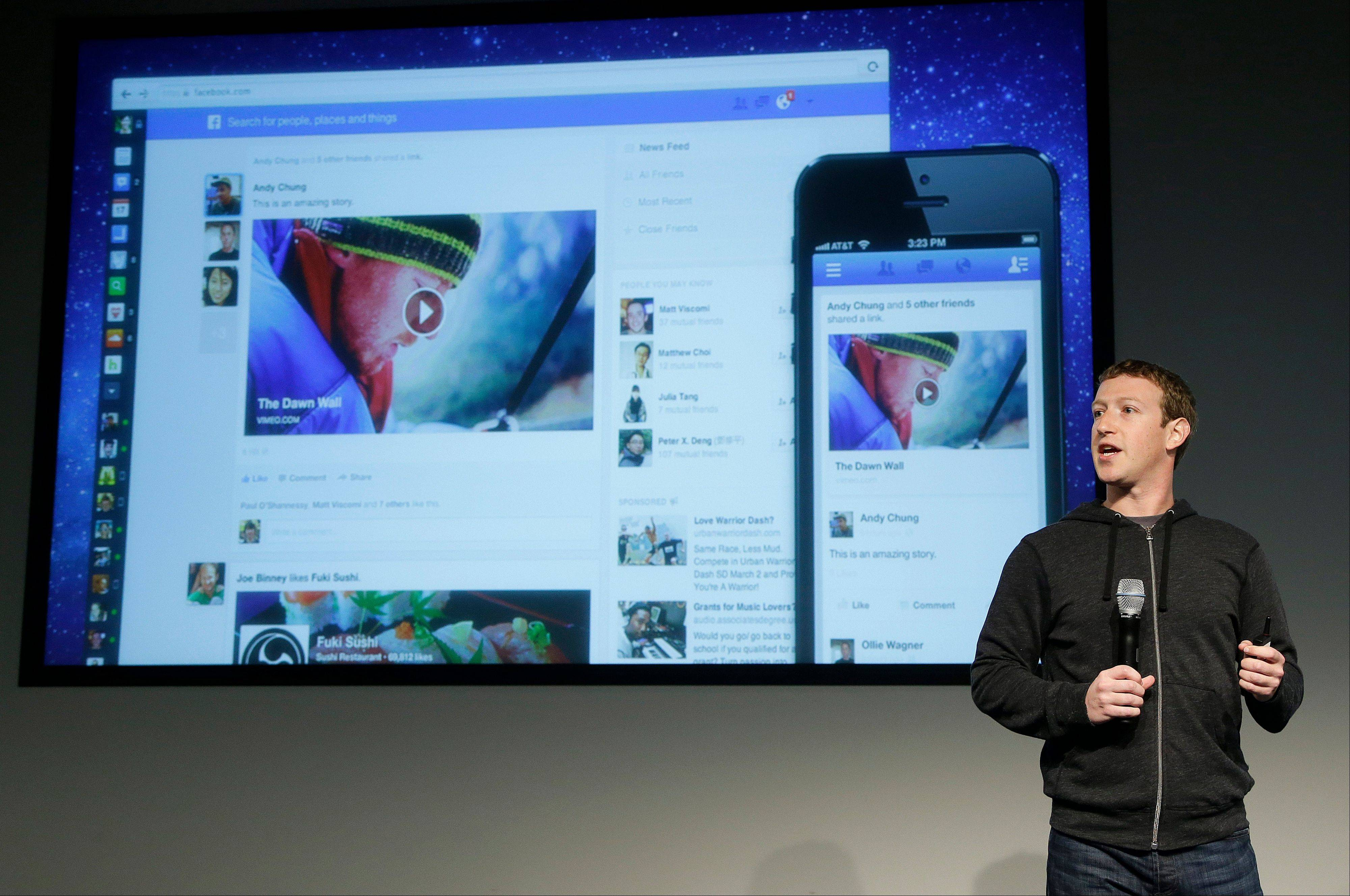 Facebook CEO Mark Zuckerberg unveils a new look for the social network's News Feed, the place where its 1 billion users congregate to see what's happening with their friends, family and favorite businesses. He spoke at Facebook headquarters in Menlo Park, Calif., Thursday.