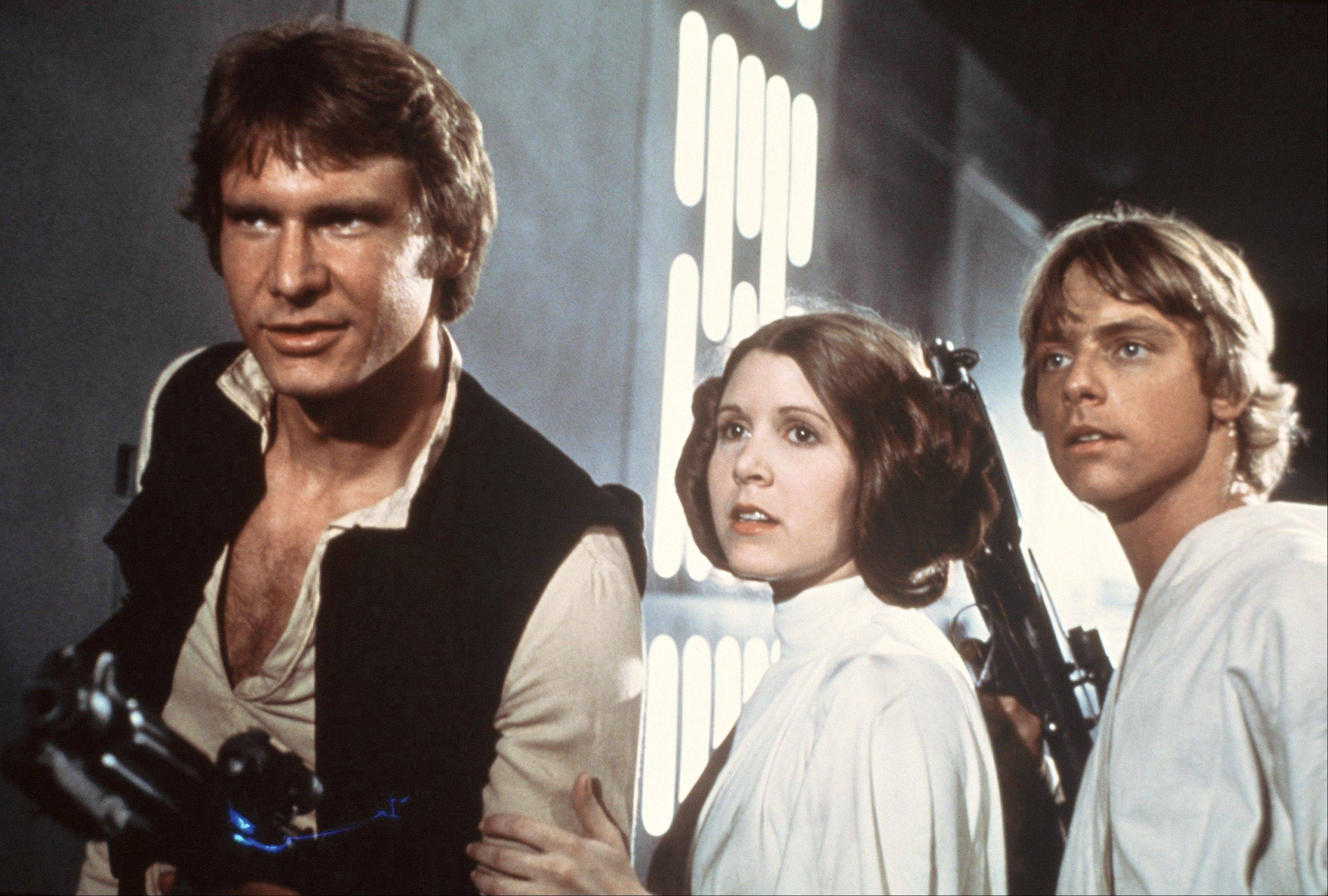 "Harrison Ford, left, Carrie Fisher and Mark Hamill starred in the original ""Star Wars"" trilogy. Fisher says she's coming back as Princess Leia for the new ""Star Wars"" films."