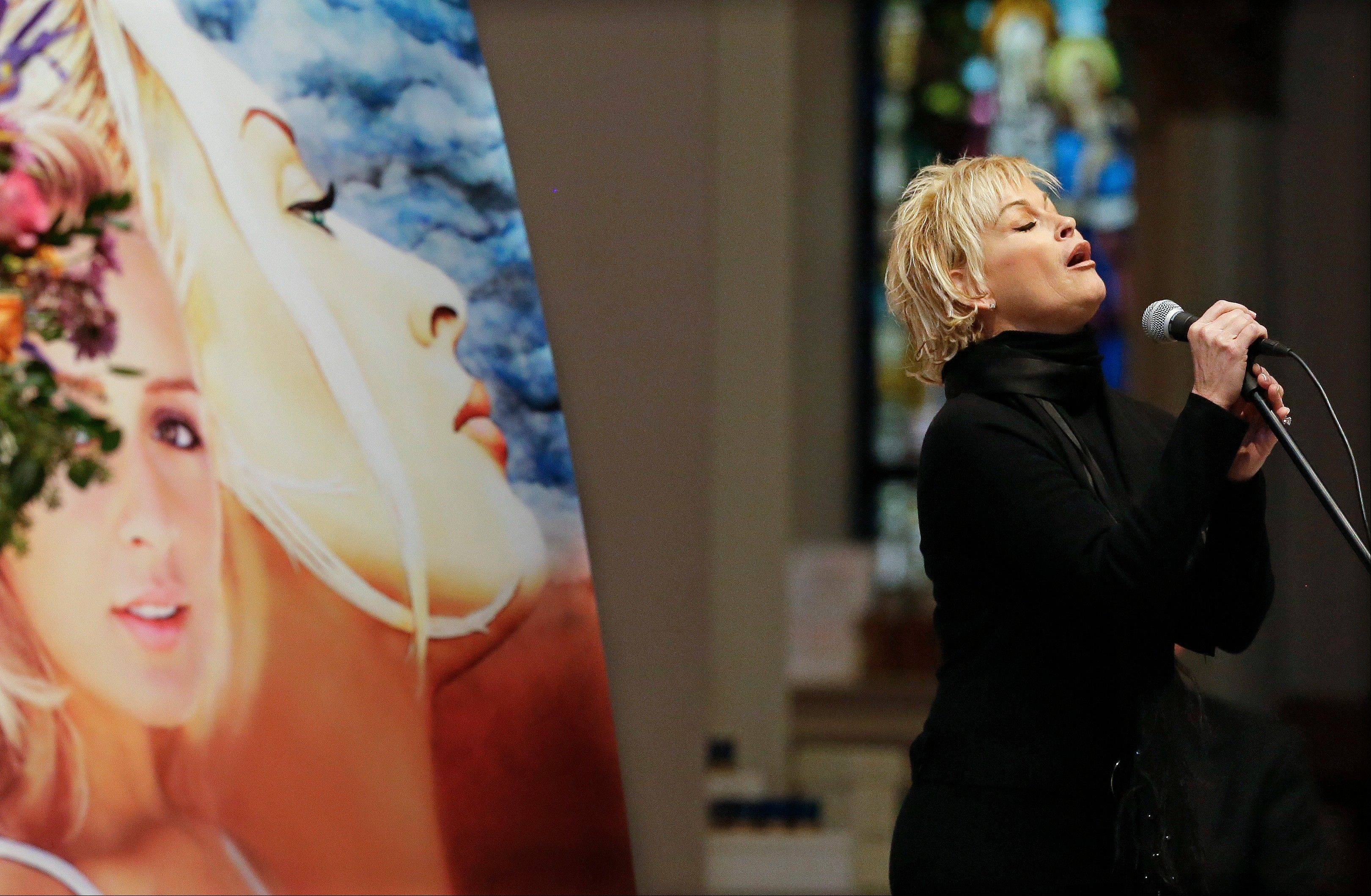 "Lorrie Morgan sings ""Ave Maria"" during a memorial service for fellow country singer Mindy McCready on Wednesday in Nashville, Tenn. McCready committed suicide Feb. 17 in Heber Springs, Ark."