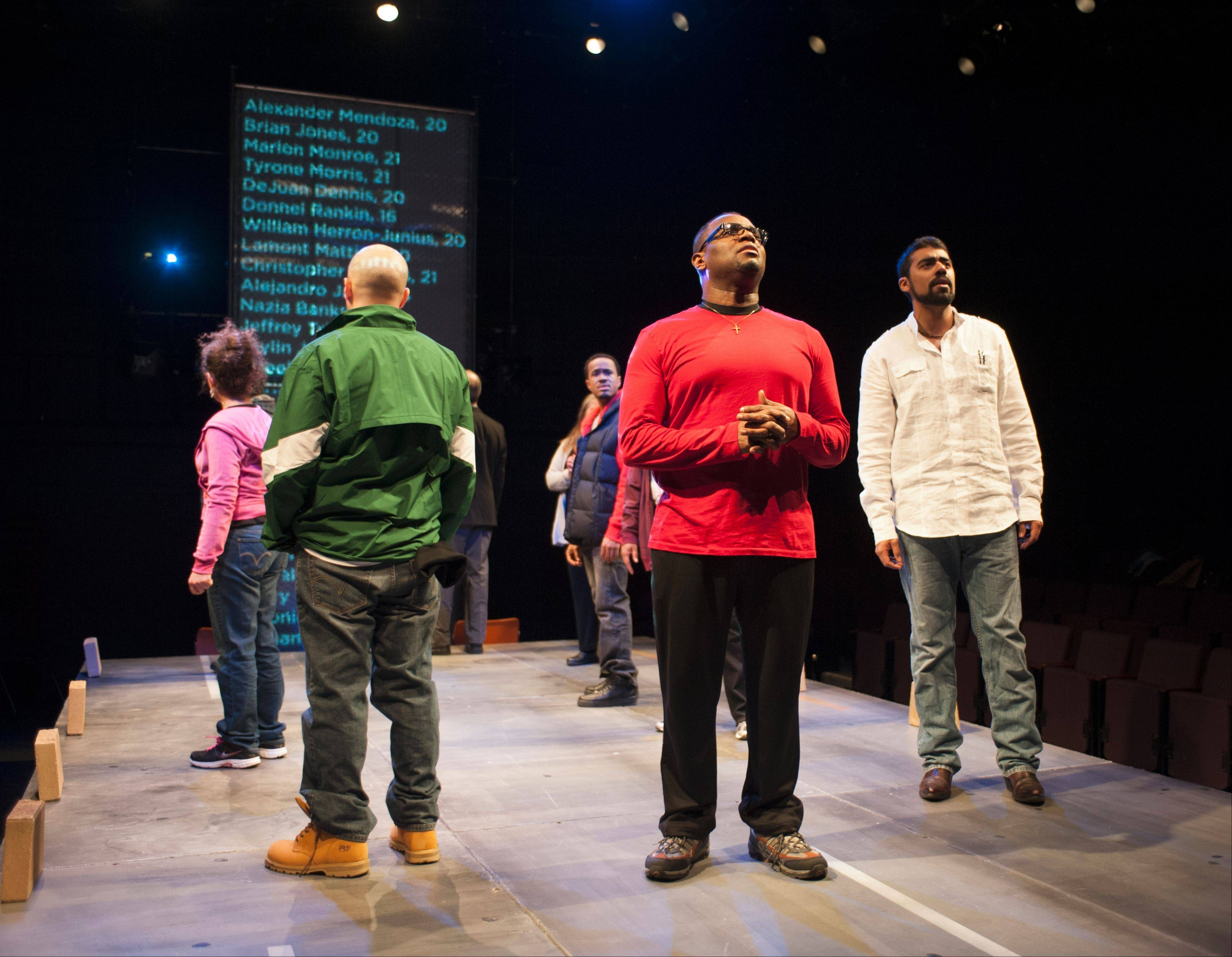 "The ensemble of Steppenwolf for Young Adults' production of ""How Long Will I Cry?: Voices of Youth Violence"" read the scrolling names of young people killed in Chicago in 2012 and 2013."