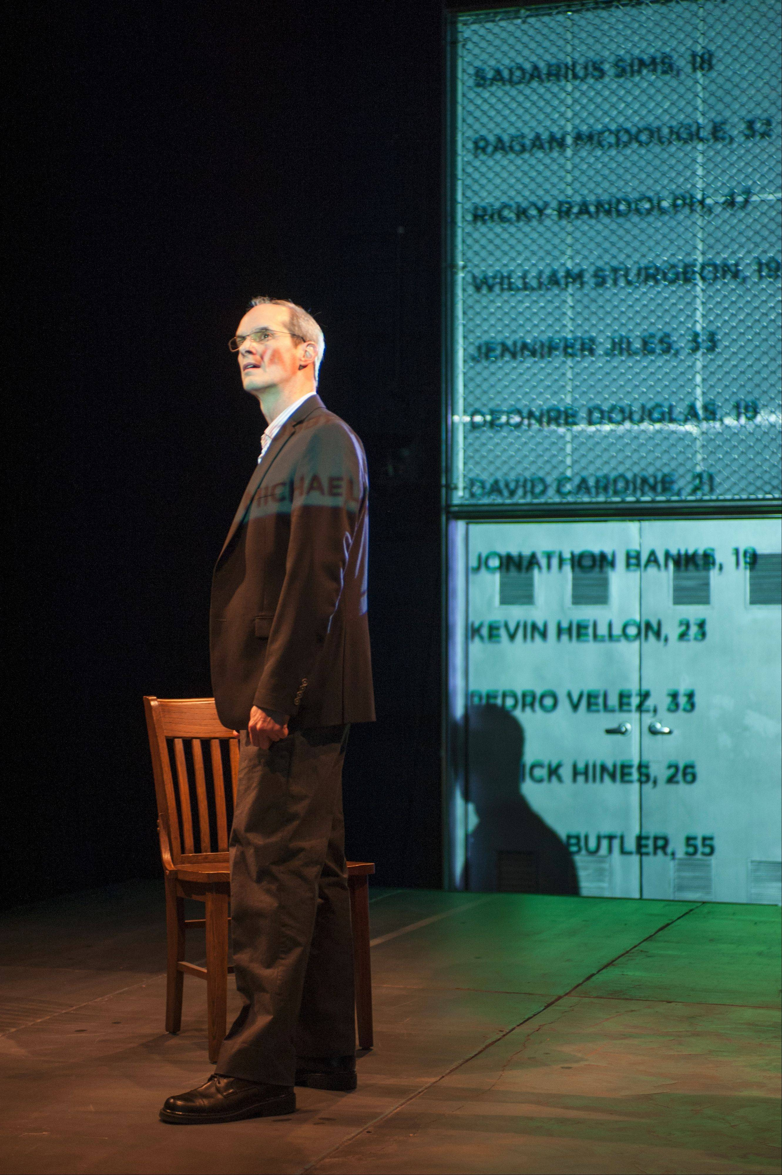 "The Narrator (Mark Ulrich) silently reads a scroll of names of people killed in Chicago's North Lawndale neighborhood in 2012 and 2013 in the Steppenwolf for Young Adults production of ""How Long Will I Cry?: Voices of Youth Violence."""