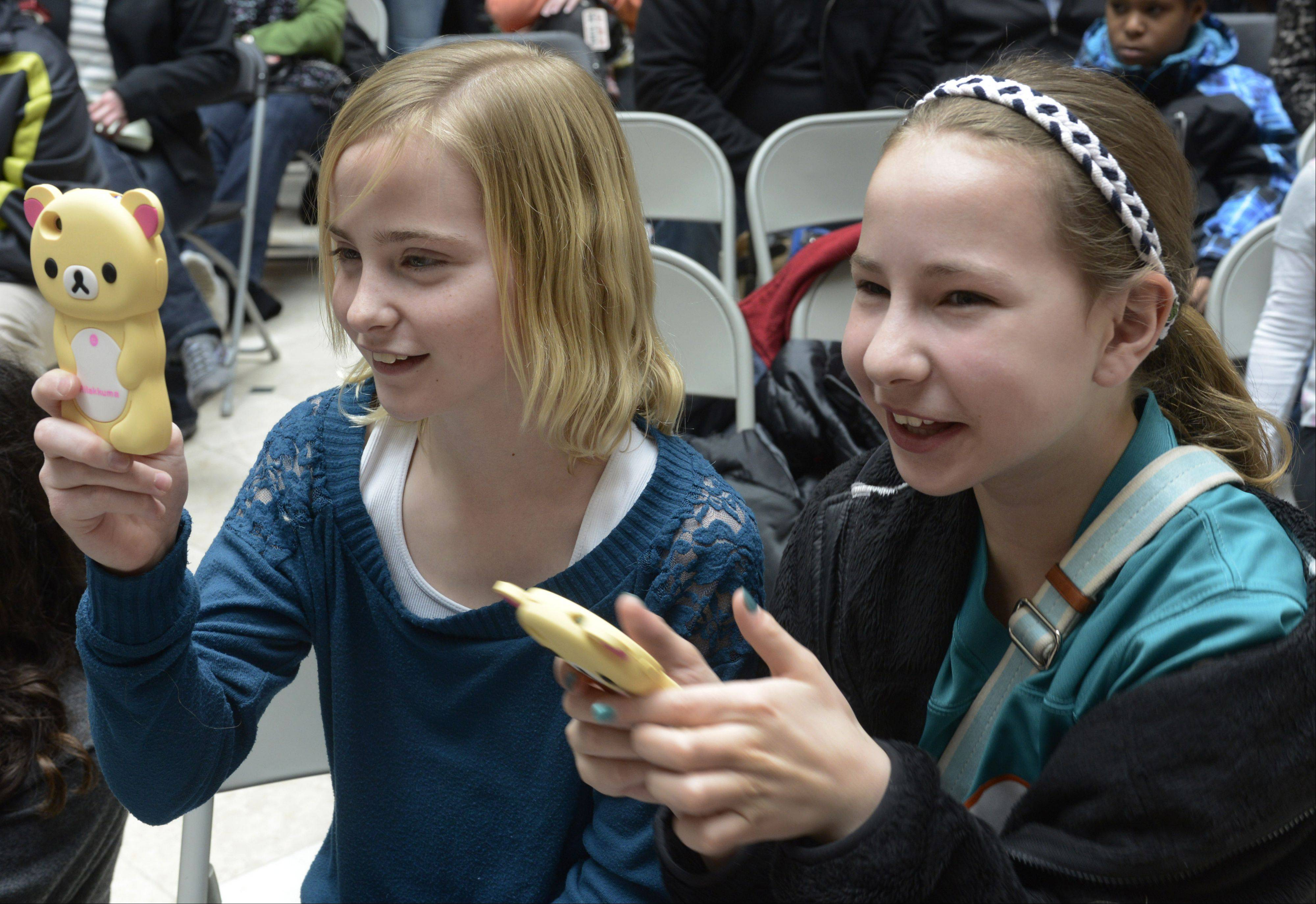 Leah Wilkowski, left, and Madison Ellis, both age 12 of Vernon Hills, shoot video during Saturday's St. Baldrick's Foundation fundraiser at Westfield Hawthorn Mall in Vernon Hills.