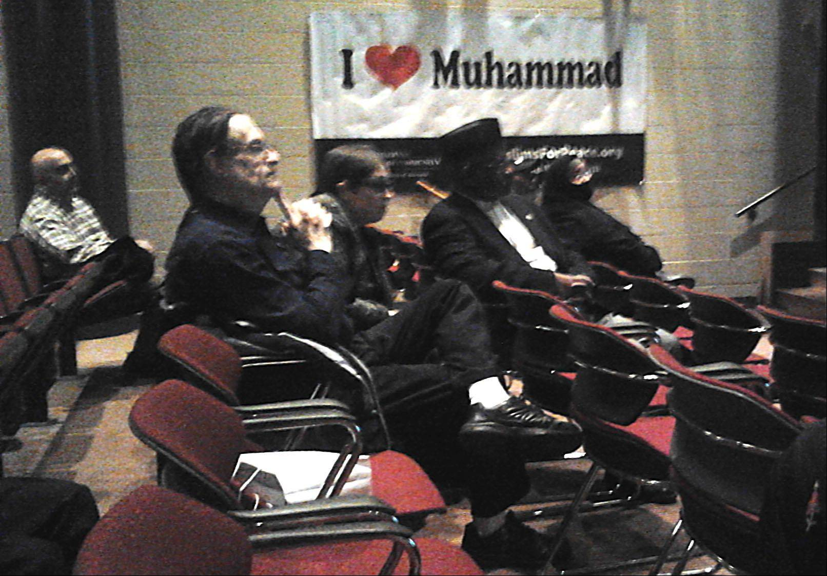 "Members of the audience listen at the ""Muhammad Messenger of Peace"" program Thursday at College of Lake County in Grayslake."