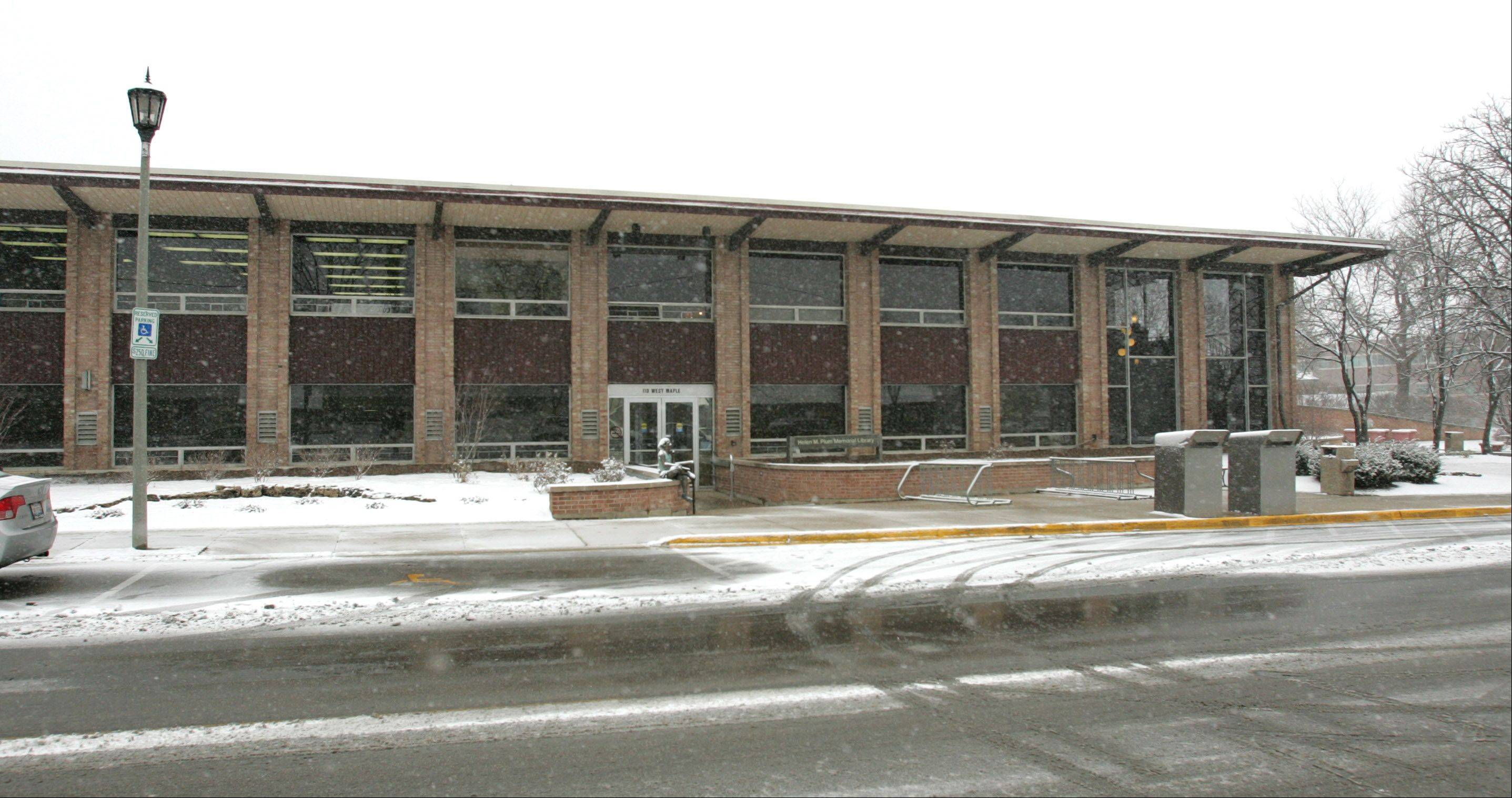 The Helen Plum Memorial Library in Lombard allowed homeless people awaiting shelter at a PADS site to stay at the library from its closing at 1 p.m. Tuesday until the shelter at First Church of Lombard opened early at 5 p.m. The collaboration provided shelter for about a dozen people throughout the snowy afternoon.