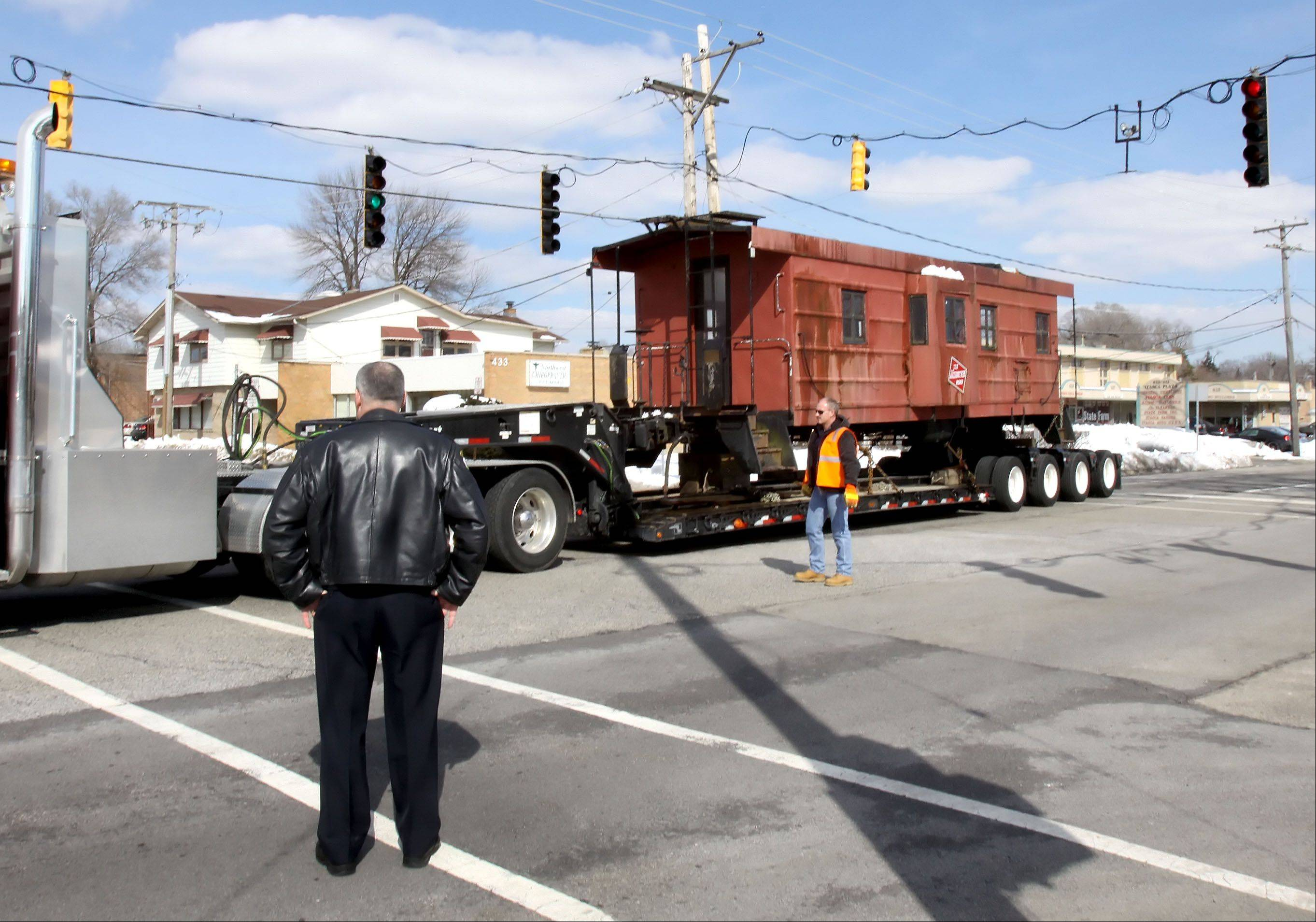 A caboose is driven through the intersection of Rowling Road and Catalpa Avenue on Thursday in Itasca. It was moved from its home on Bloomingdale Road to its new home at the Itasca Historical Depot Museum.