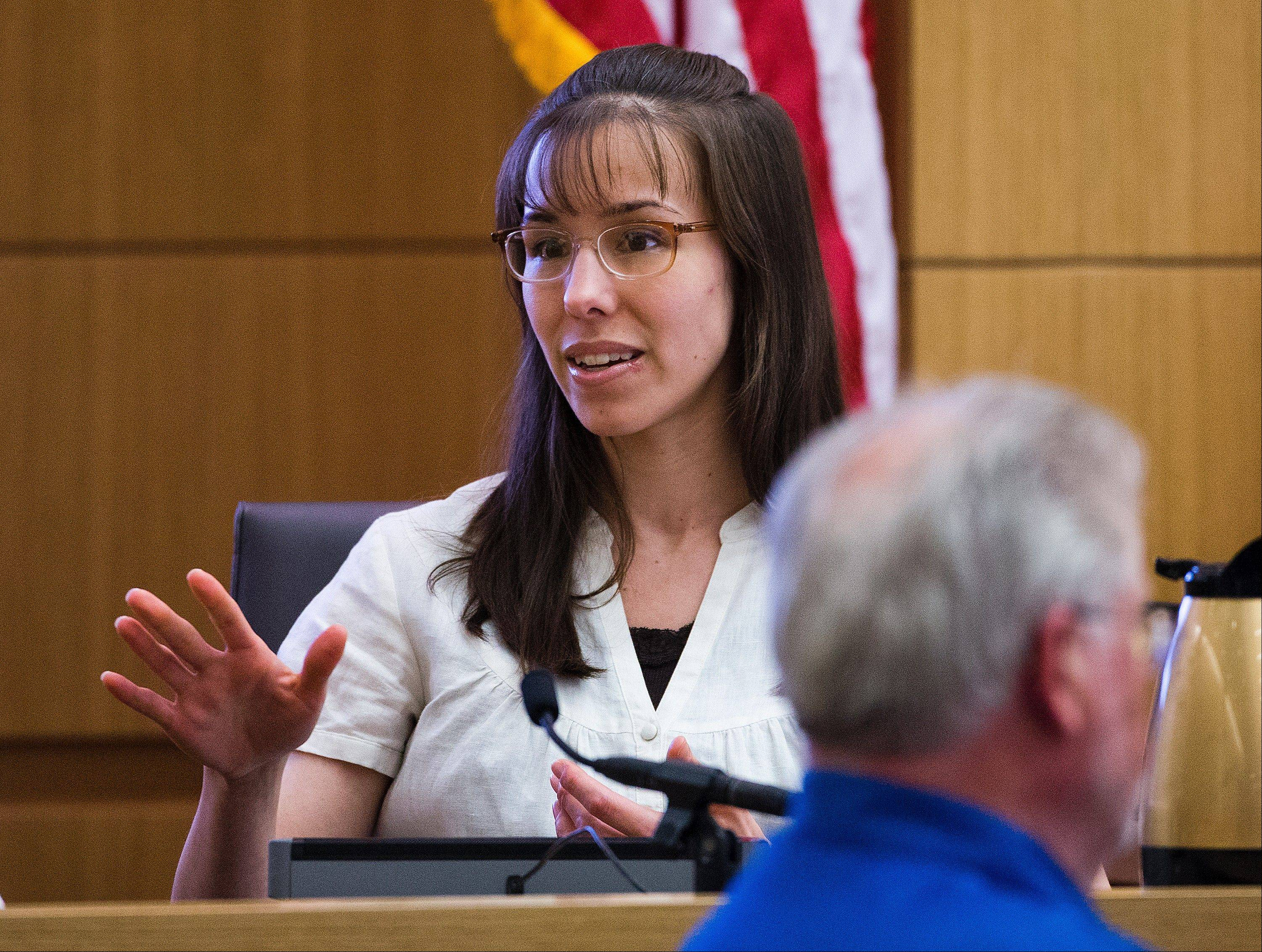 Jodi Arias answers written questions from the jury during her murder trial, Wednesday, March 6, 2013 in Maricopa County Superior Court in Phoenix. Arias is on trial for the 2008 murder of Travis Alexander.