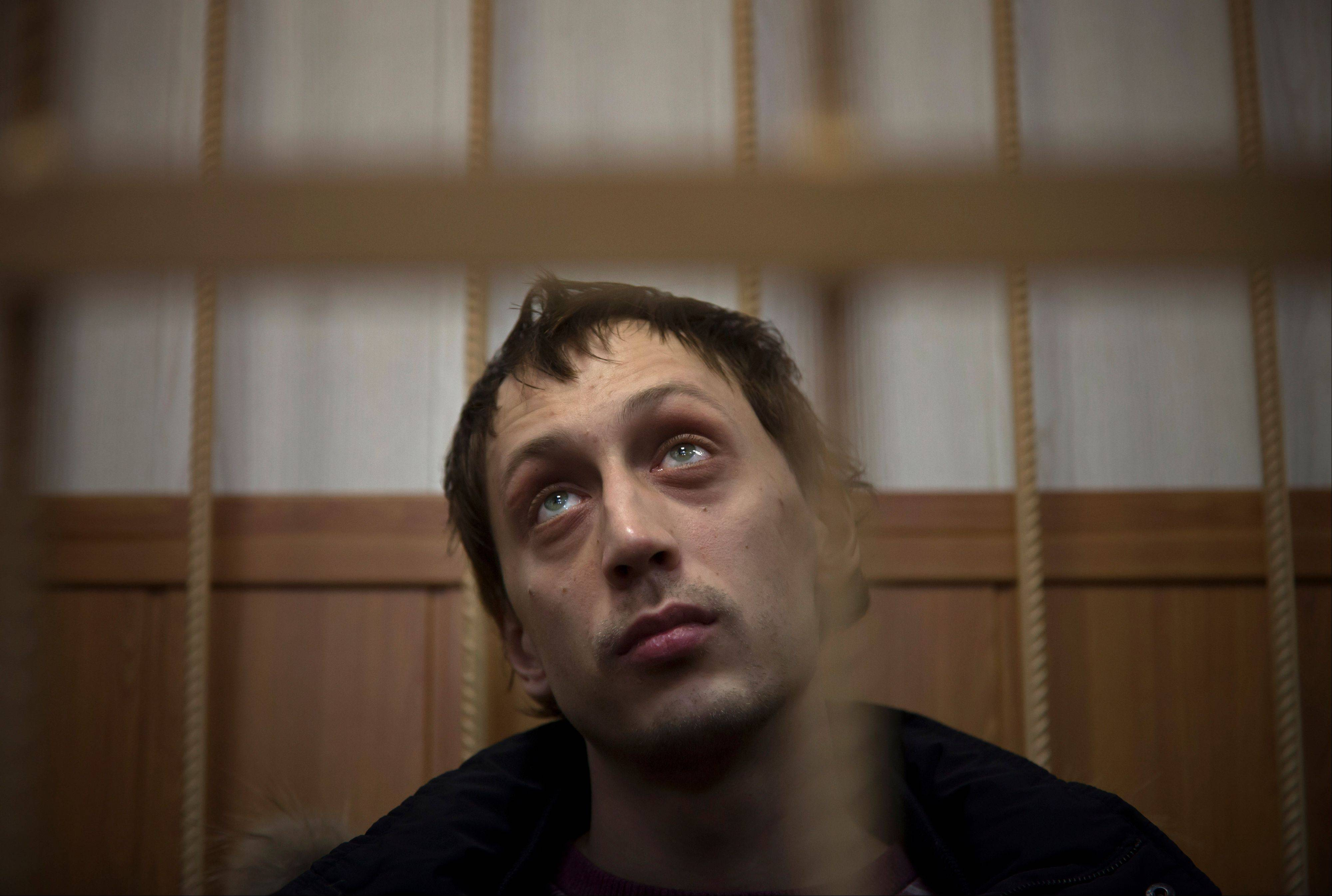 "Bolshoi soloist Pavel Dmitrichenko listens in a courtroom in Moscow, Russia, Thursday, March 7, 2013. The star dancer accused of masterminding the attack on the Bolshoi ballet chief acknowledged Thursday that he gave the go-ahead for the attack, but said he did not order anyone to throw acid on the artistic director's face. Dmitrichenko told a Moscow court that he had complained about ballet chief Sergei Filin to an acquaintance, who offered to ""beat him up."""