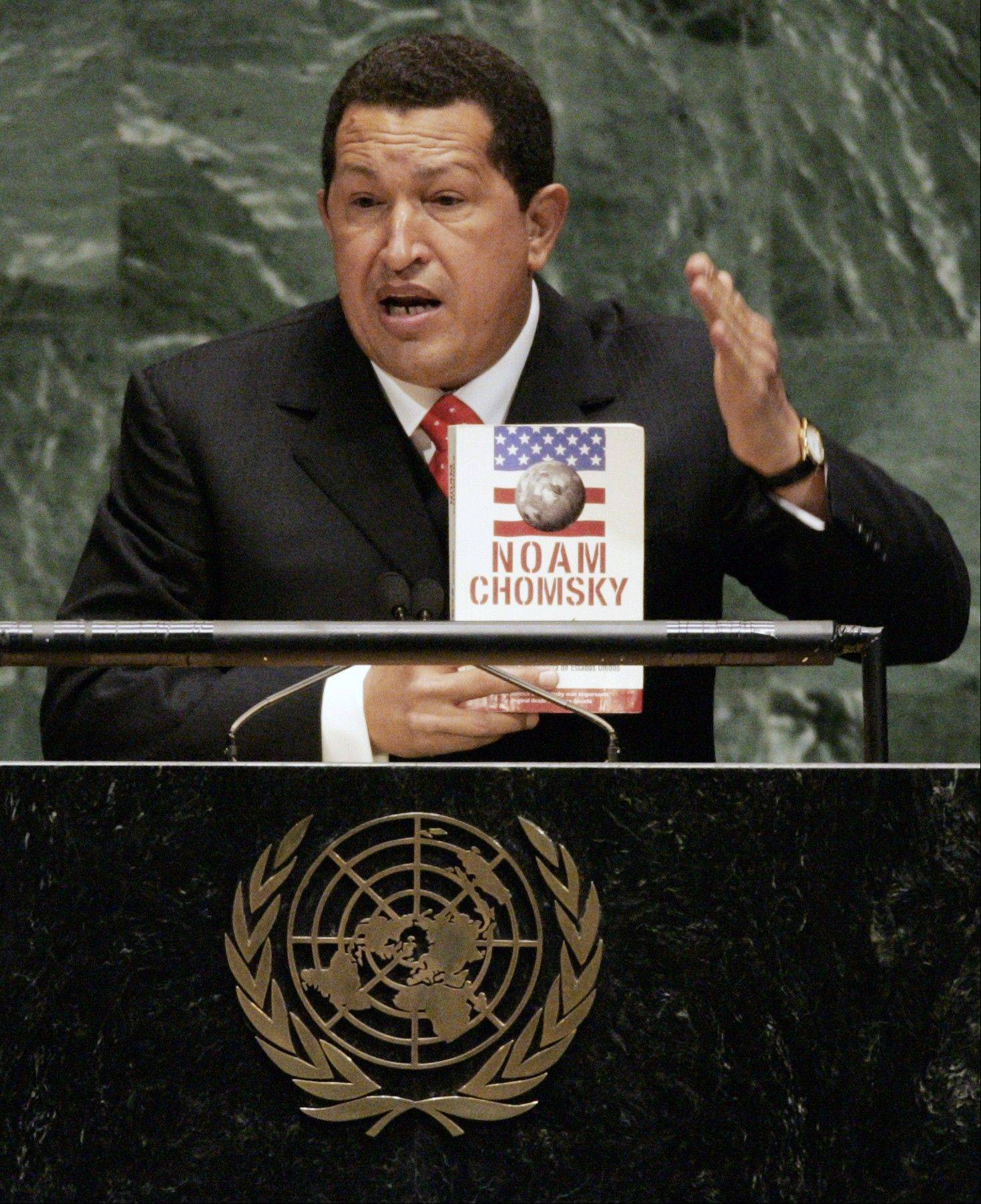 "In this 2006 file photo, Venezuelan President Hugo Chavez holds a Spanish-language version of ""Hegemony or Survival: America's Quest for Global Dominance"" by Noam Chomsky while addressing the 61st session of the United Nations General Assembly at U.N. headquarters. During his address, Chavez, who often tried to cast himself as a champion of the American poor, called President George W. Bush ""the devil."""