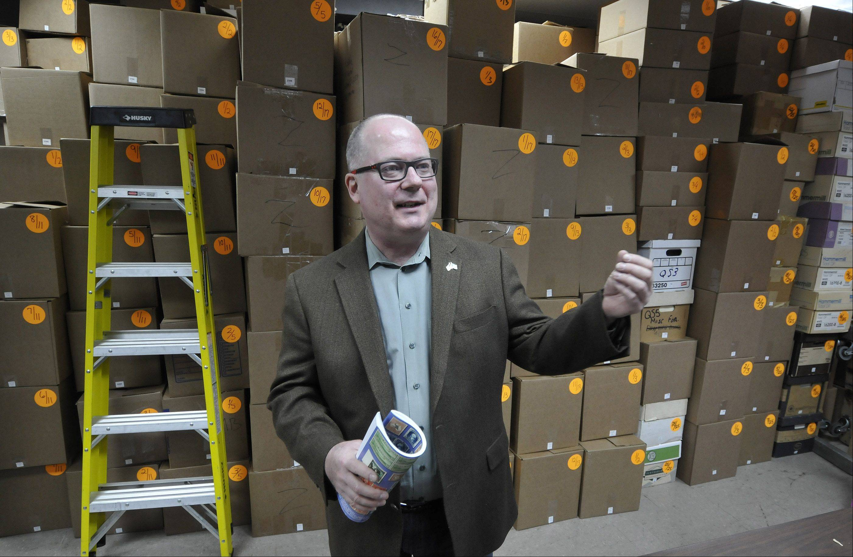 A rare stamp might be worth thousands of dollars, but most old stamps sell by the pound in these cartons at Rasdale Stamps in Westmont. Kim Kellermann, grandson of the founder, says Rasdale typically moves between 8 tons and 10 tons of stamps a year at each of their four auctions.