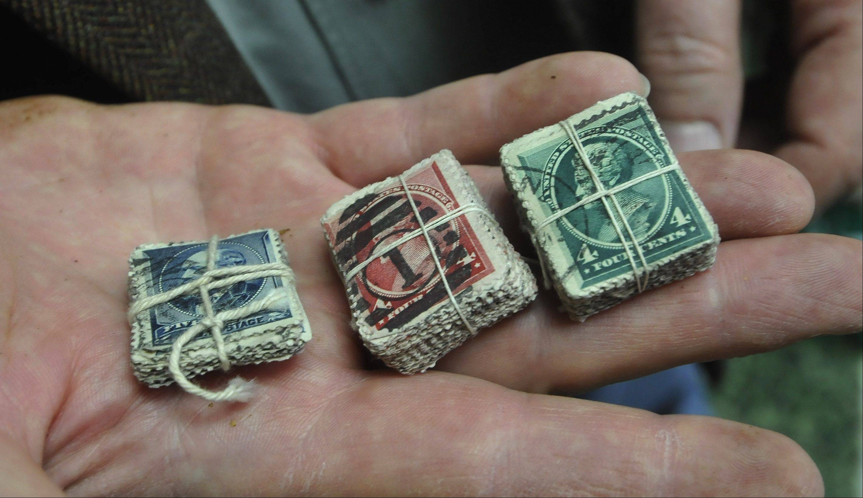 As an 8-year-old boy, Kim Kellermann got his start in the Rasdale Stamps family business by sorting and bundling these stamps from the 1870s.