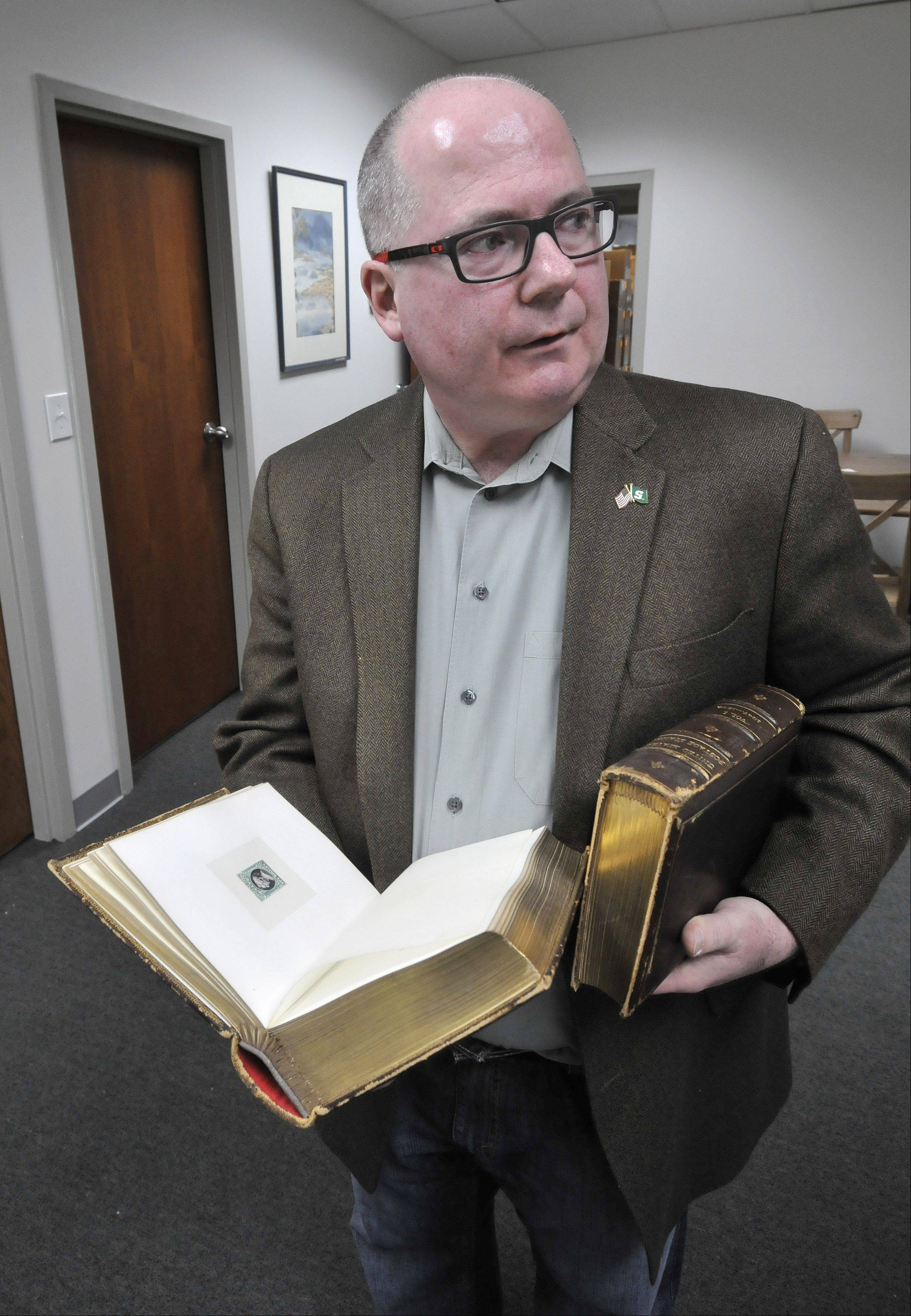 Stamp collecting is about more than stamps. Kim Kellermann, an owner of Rasdale Stamps in Westmont, says these display books of stamps used by a salesman to drum up printing business during the 1893 Columbian Exposition in Chicago are worth five figures.